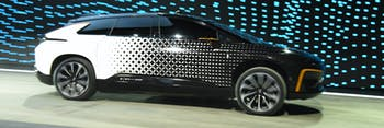 LAS VEGAS, NV - JANUARY 03: Faraday Future's FF 91 prototype electric crossover vehicle is shown during a speed test as it is unveiled during a press event for CES 2017 at The Pavilions at Las Vegas Market on January 3, 2017 in Las Vegas, Nevada. The 1,050-horsepower FF 91 features autonomous driving with 3D lidar and can go from 0 to 60 mph in 2.39 seconds. CES, the world's largest annual consumer technology trade show, runs from January 5-8 and is expected to feature 3,800 exhibitors showing off their latest products and services to more than 165,000 attendees. (Photo by Ethan Miller/Getty Images)