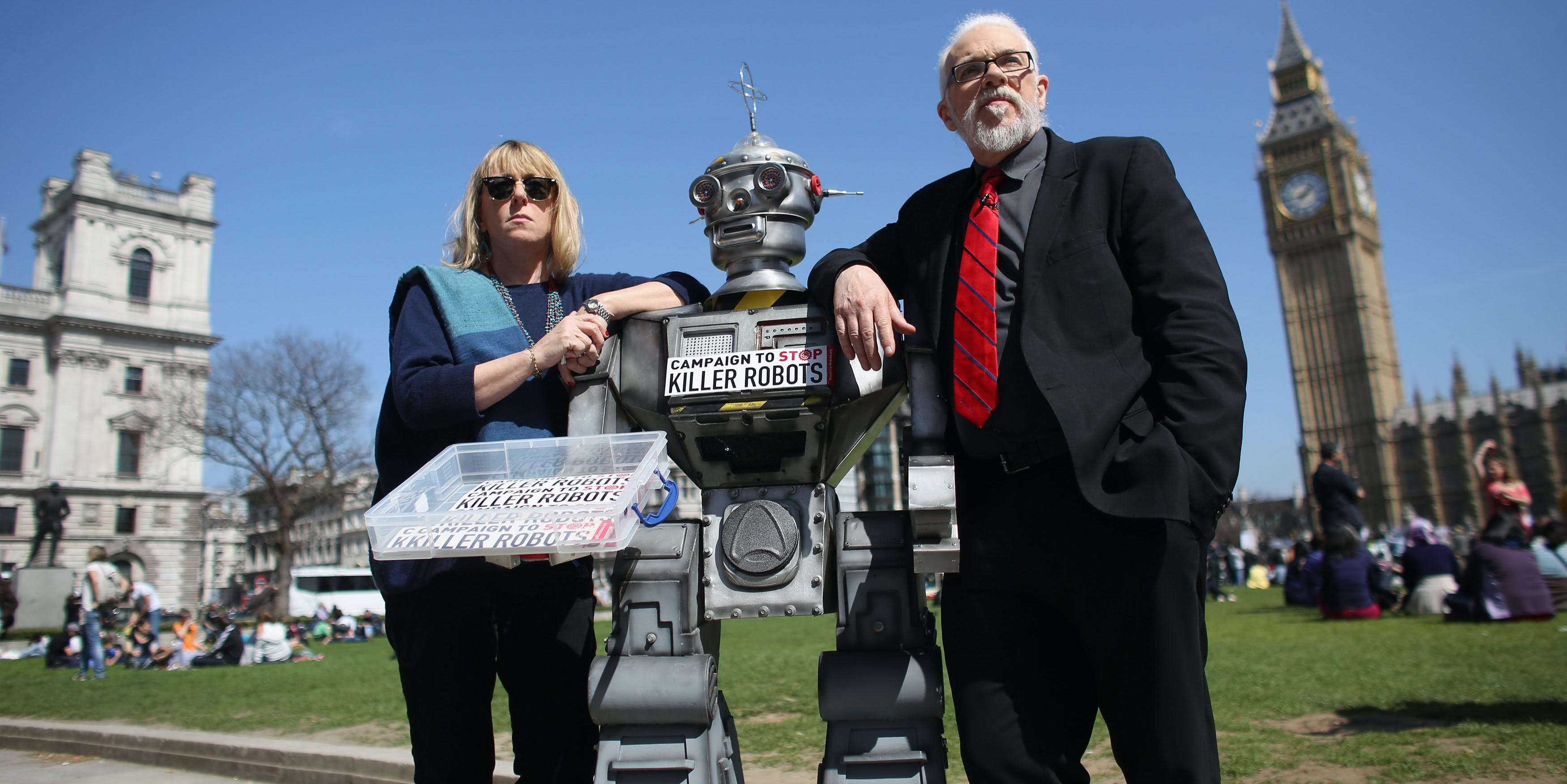 Jody Williams, a Nobel Peace Laureate, and Professor Noel Sharkey, the chair of the International Committee for Robot Arms Control, pose with a robot at a protest.
