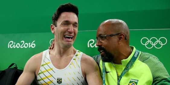 RIO DE JANEIRO, BRAZIL - AUGUST 14:  Diego Hypolito (L) of Brazil is congratulated by his coach as a medal is confirmed after Kenzo Shirai of Japan competed in the Men's Floor Exercise on Day 9 of the Rio 2016 Olympic Games at the Rio Olympic Arena on August 14, 2016 in Rio de Janeiro, Brazil.  (Photo by Alex Livesey/Getty Images)