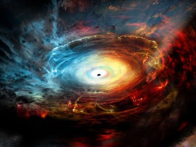 """Supermassive Black Hole Hides Inside Its Own """"Exhaust"""""""