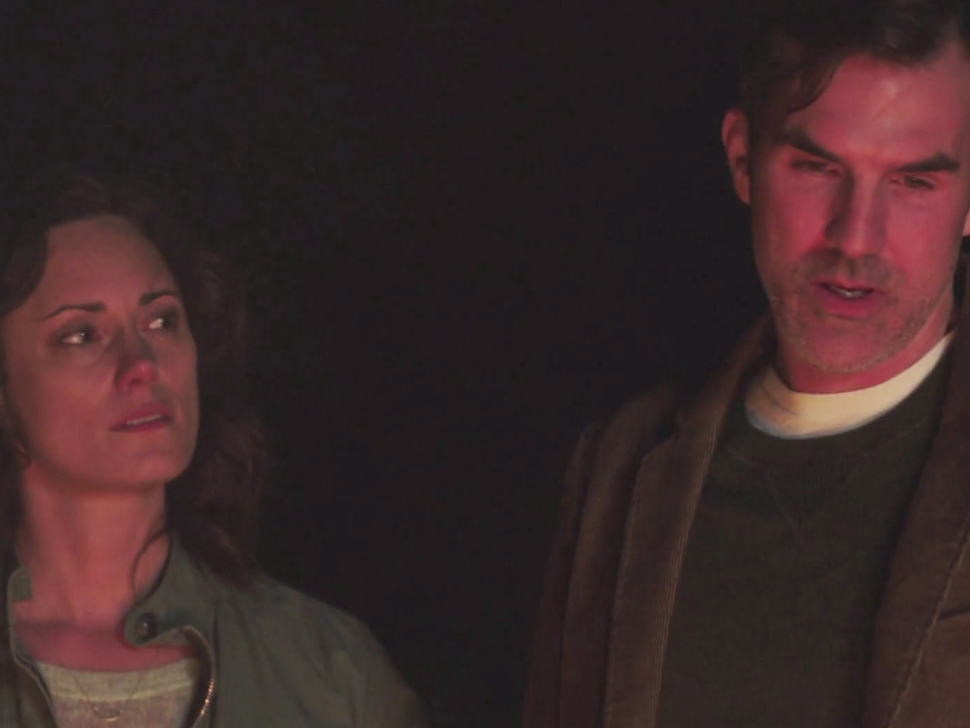 Jessica and Mike in the warm glow of a burning child's corpse.