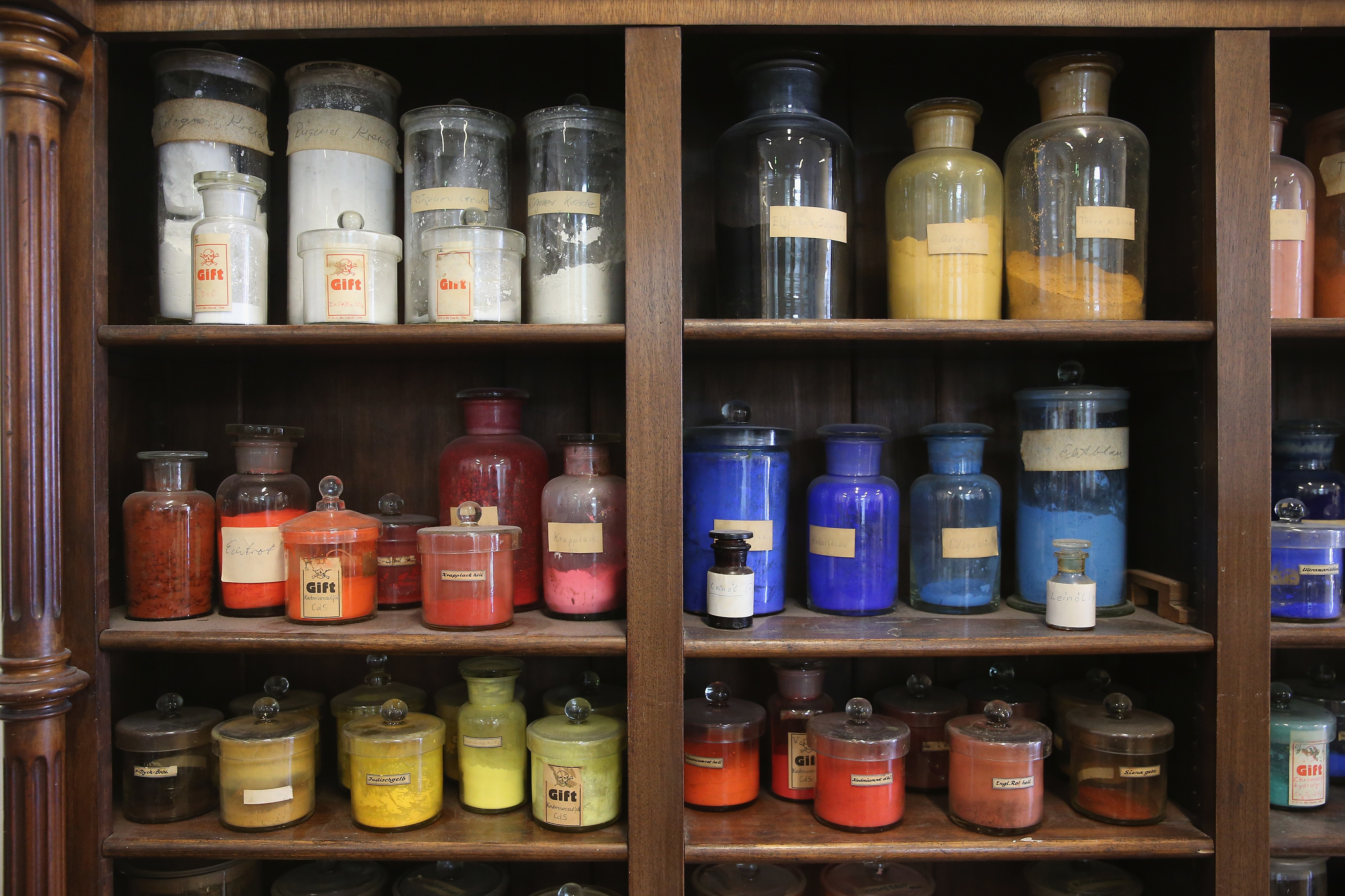 Old pigments and other agents once used for restoration work stand on a shelf at the restoration studio of the Gemaeldegalerie museum.