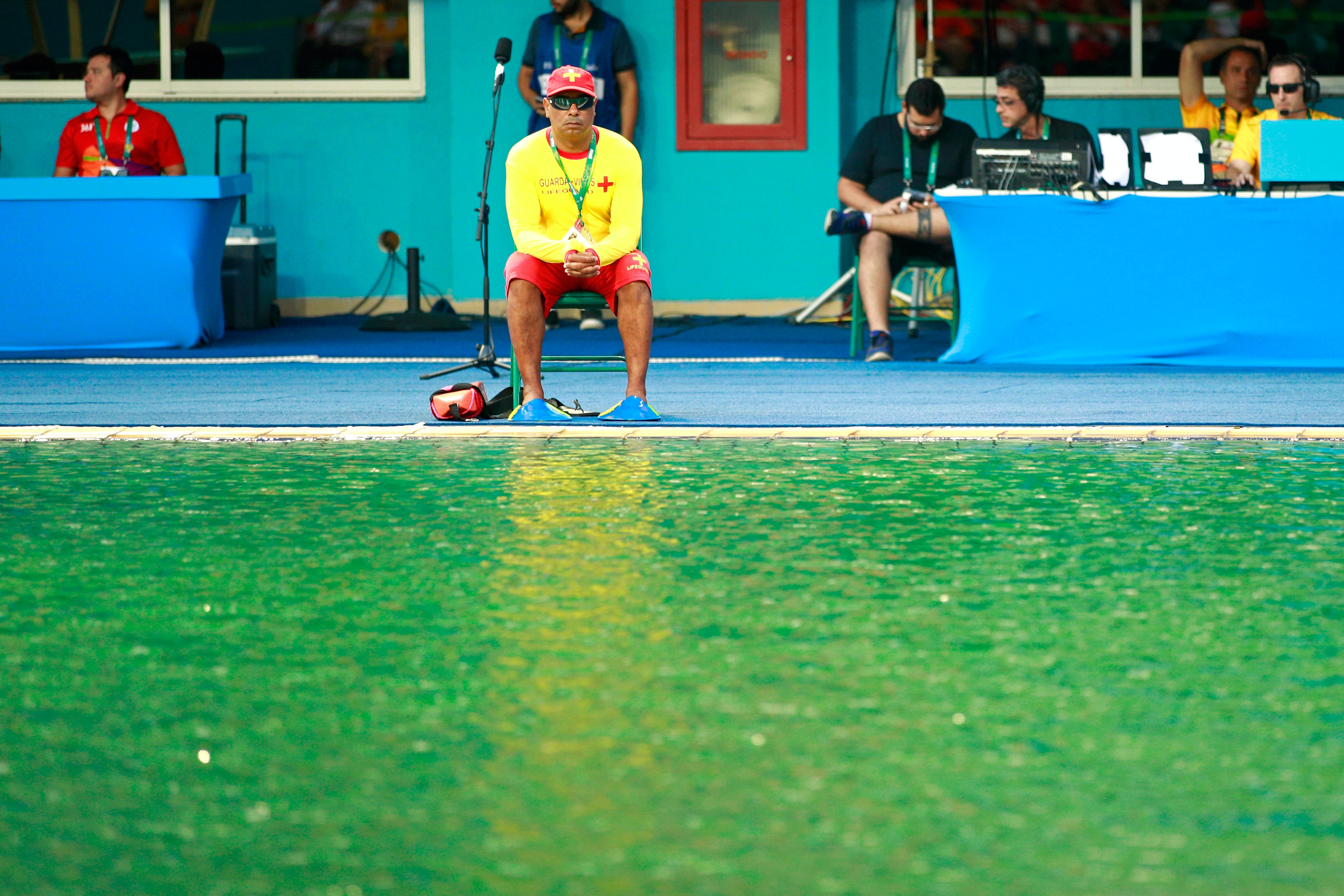 A lifeguard sits by the edge of the diving pool during the Women's Diving Synchronised 10m Platform Final.