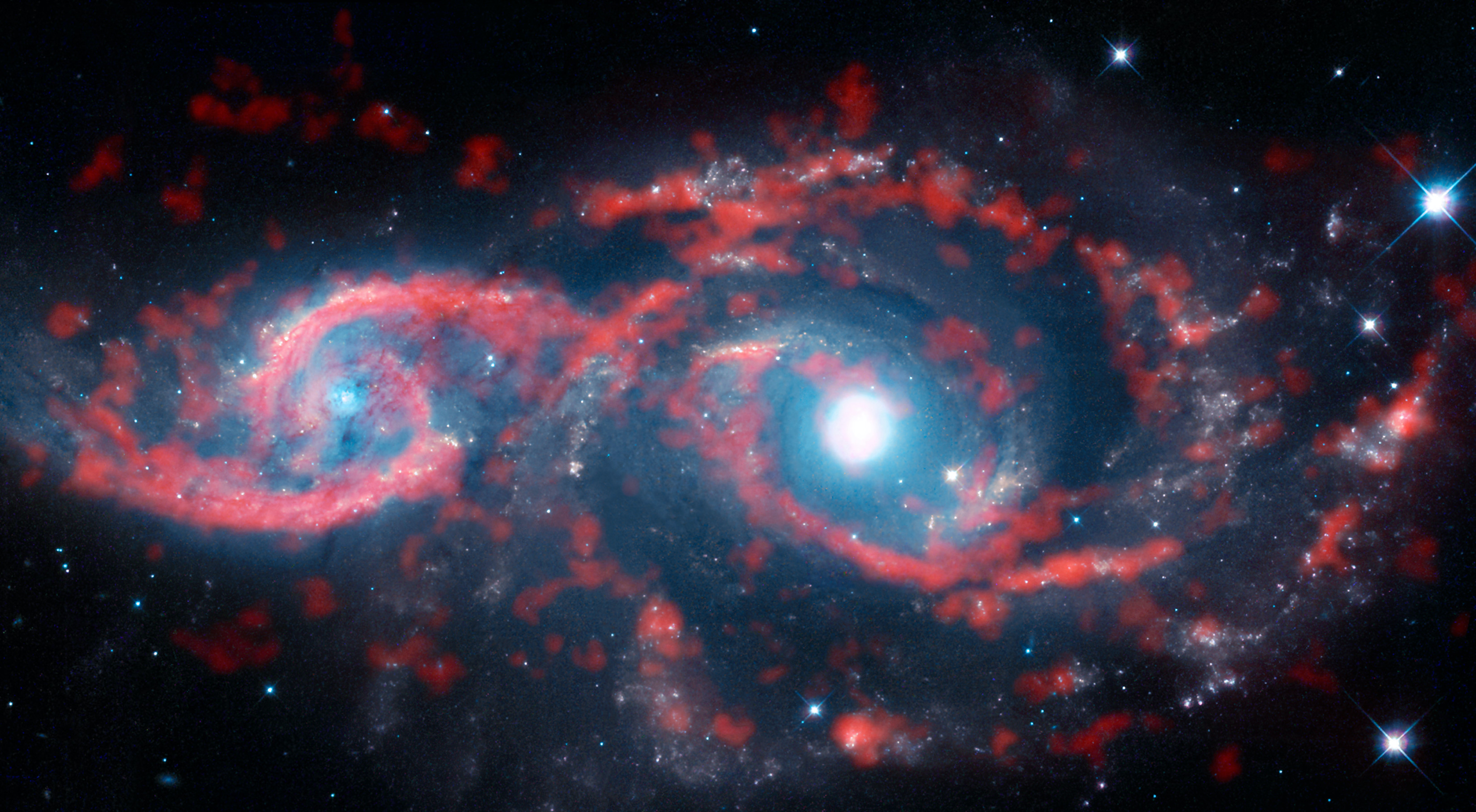 Two Galaxies are Colliding and Forming a Bizarre Galactic Eye