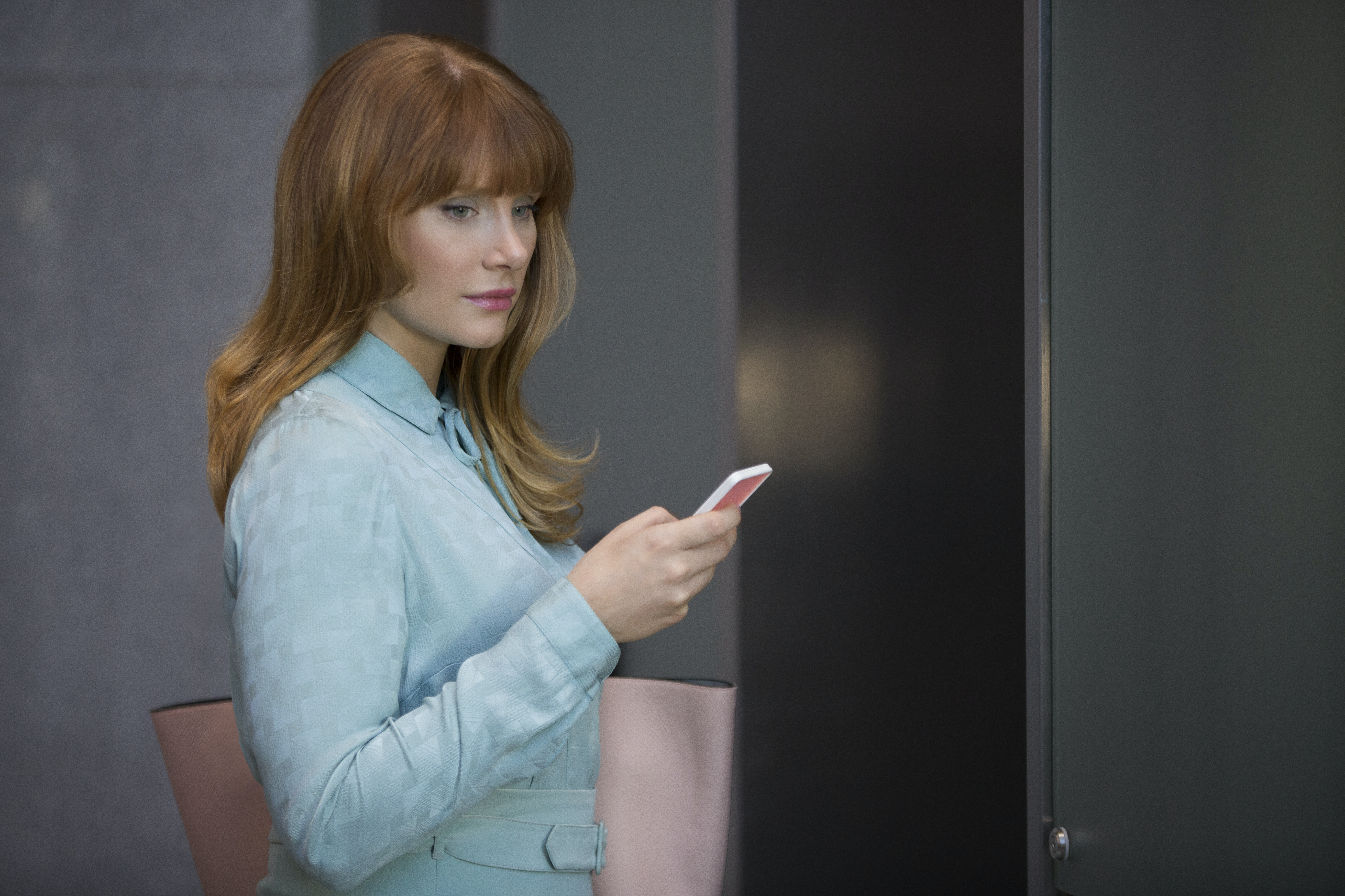Bryce Dallas Howard is very concerned about her phone.