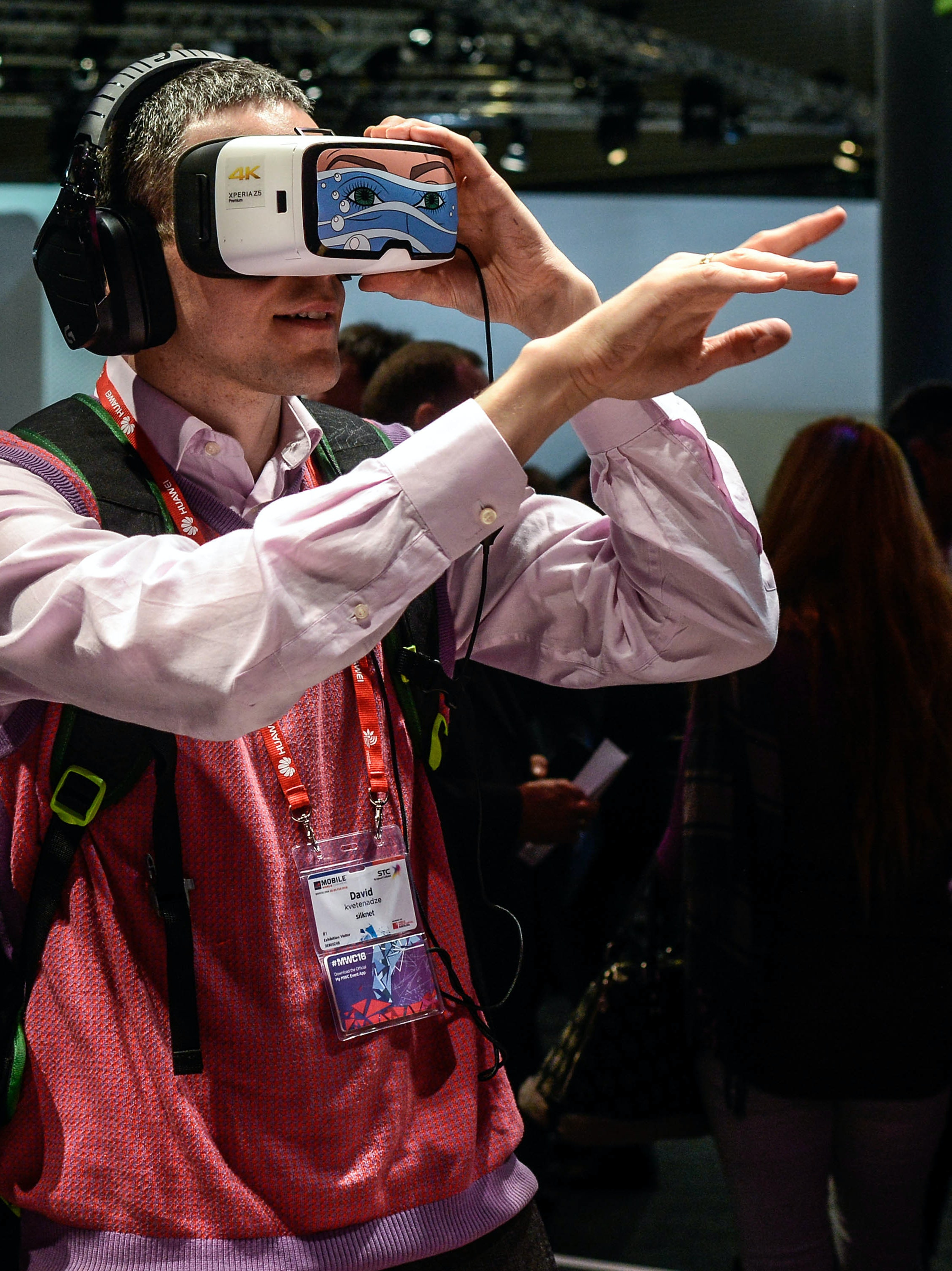 BARCELONA, SPAIN - FEBRUARY 23:  Visitors use Oculus VR virtual reality devices at Deutsche Telekom pavilion on the second day of the event at the Fira Gran Via Complex on day 2 of the Mobile World Congress on February 23, 2016 in Barcelona, Spain. The annual Mobile World Congress hosts some of the world's largest communications companies, with many unveiling their latest phones and wearables gadgets.  (Photo by David Ramos/Getty Images)