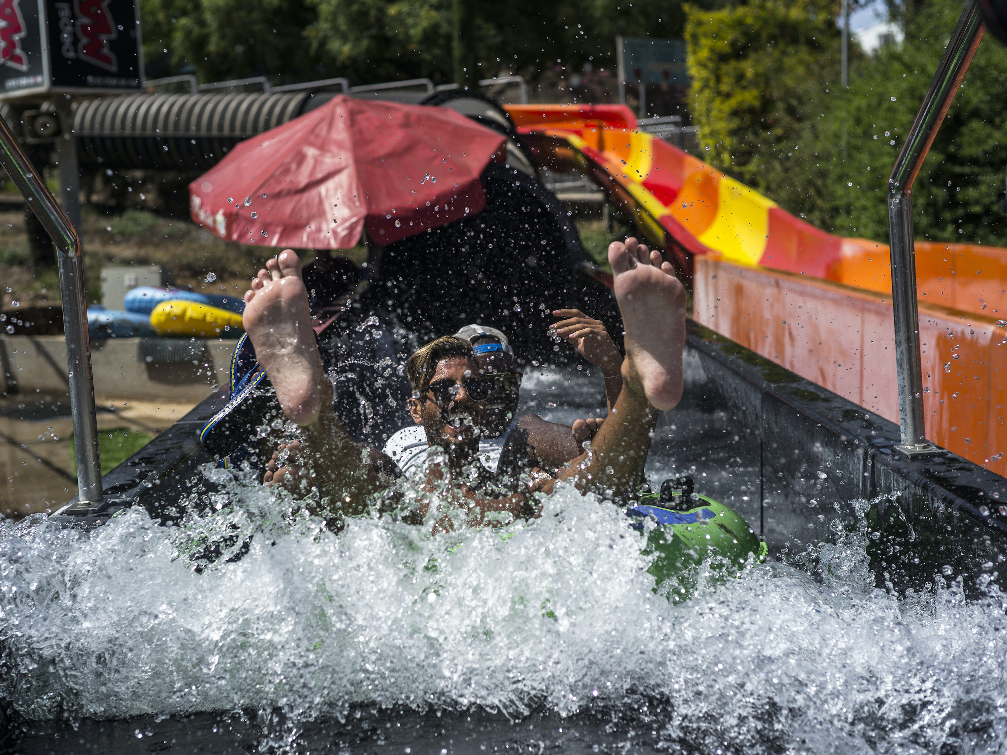 SHEFAYIM, ISRAEL - JUNE 02:  People enjoy the water slides during a Water Park party on June 2, 2016 in Shefayim, Israel. Ahead of the annual Gay pride parade in Tel Aviv taking place on June 3, LGBT tourists from across the world visit Israel for the week in a build-up to Tel Aviv Pride, one of the Pride capitols of the world.  (Photo by Ilia Yefimovich/Getty Images)