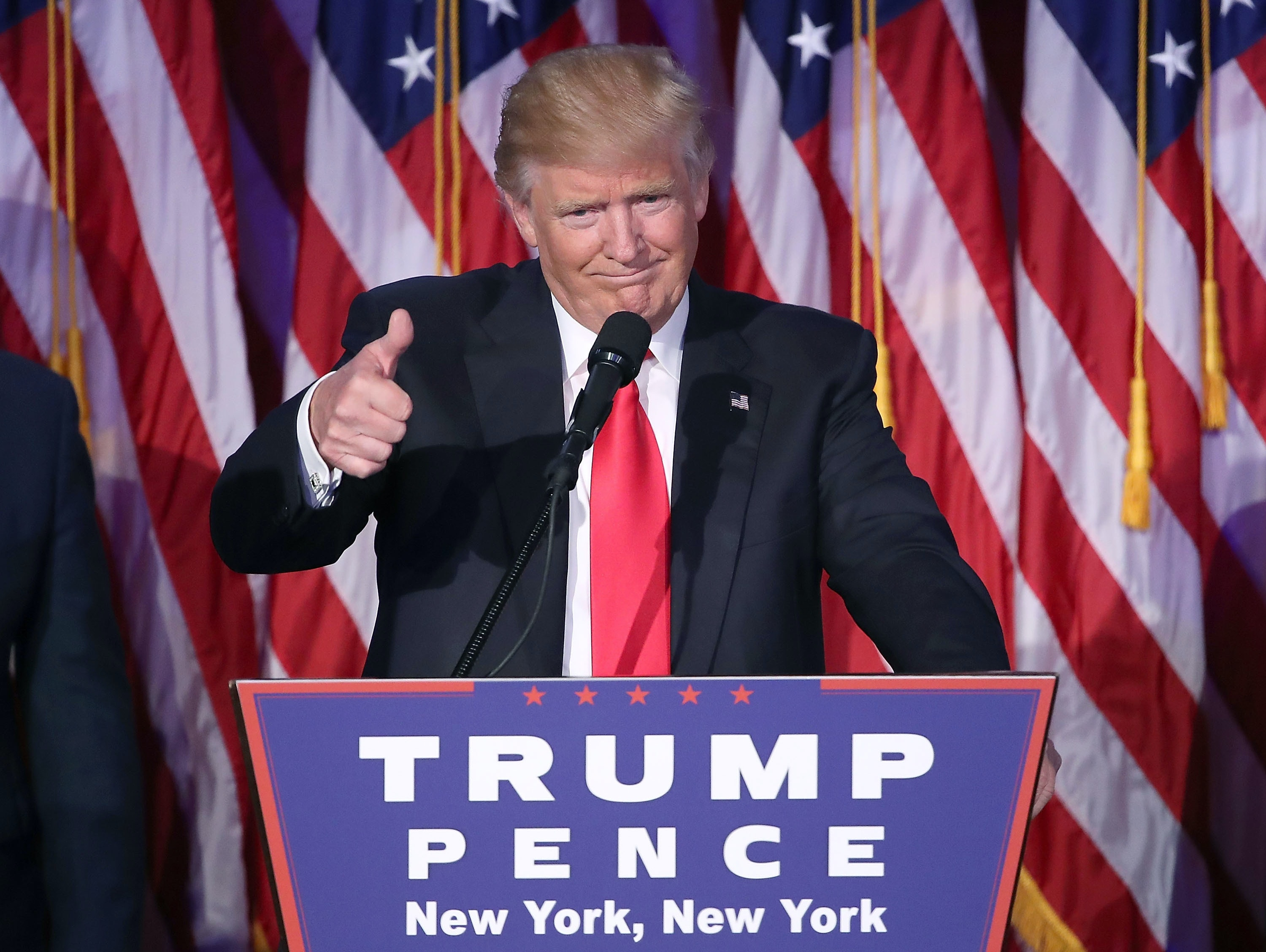 NEW YORK, NY - NOVEMBER 09:   Republican president-elect Donald Trump gives a thumbs up to the crowd during his acceptance speech at his election night event at the New York Hilton Midtown in the early morning hours of November 9, 2016 in New York City. Donald Trump defeated Democratic presidential nominee Hillary Clinton to become the 45th president of the United States. (Photo by Mark Wilson/Getty Images)