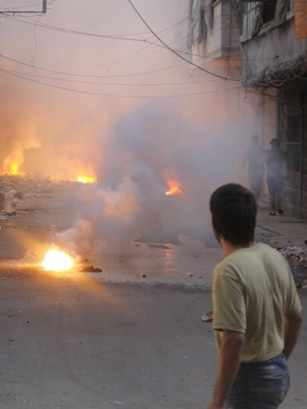Incendiary devices burn in the al-Mashhad neighborhood of Aleppo in August.