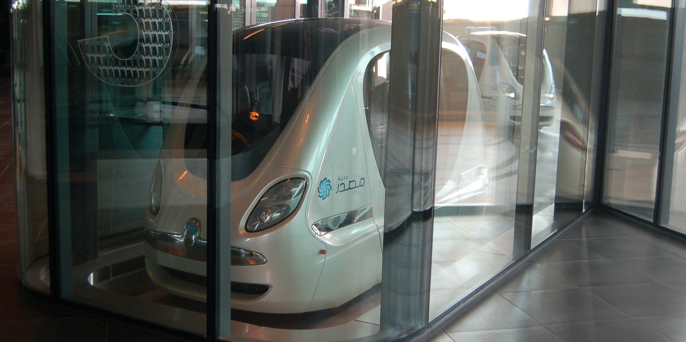 Masdar City Rapid Personal Transport  looks like Google's driverless cars had an affair with a monorail.