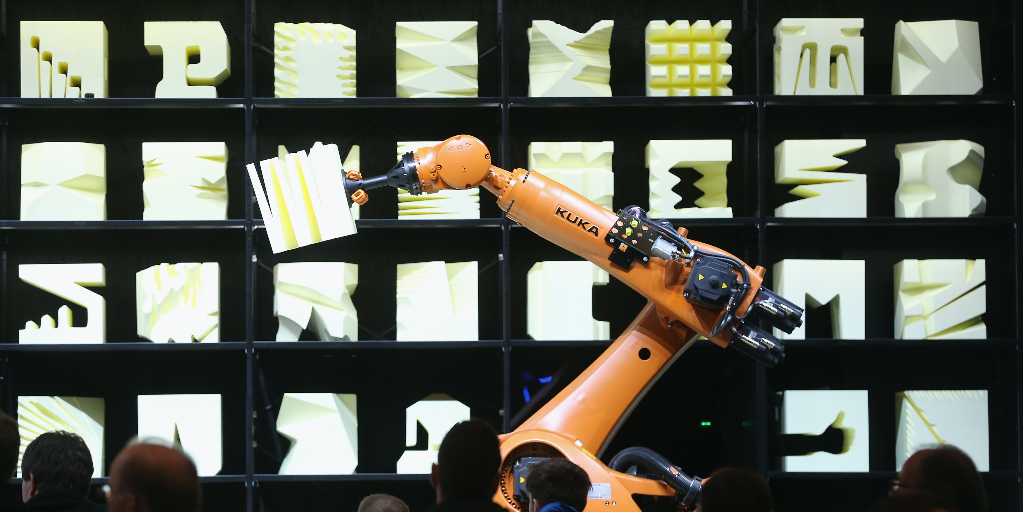 HANOVER, GERMANY - MARCH 16:  Visitors watch a Kuka robot perform precise movements as part of the Robochop interactive robot installation at the 2015 CeBIT technology trade fair on March 16, 2015 in Hanover, Germany. China is this year's CeBIT partner. CeBIT is the world's largest tech fair and will be open from March 16 through March 20.  (Photo by Sean Gallup/Getty Images)
