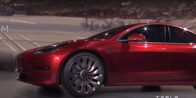 Tesla reveals the Model 3 during a live streamed event.