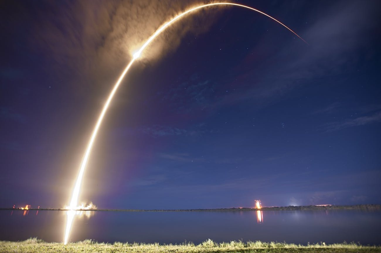 The arc of a successful rocket launch.