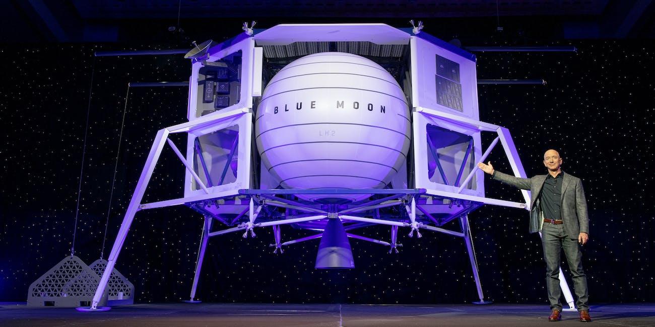 Jeff Bezos next to Blue Moon