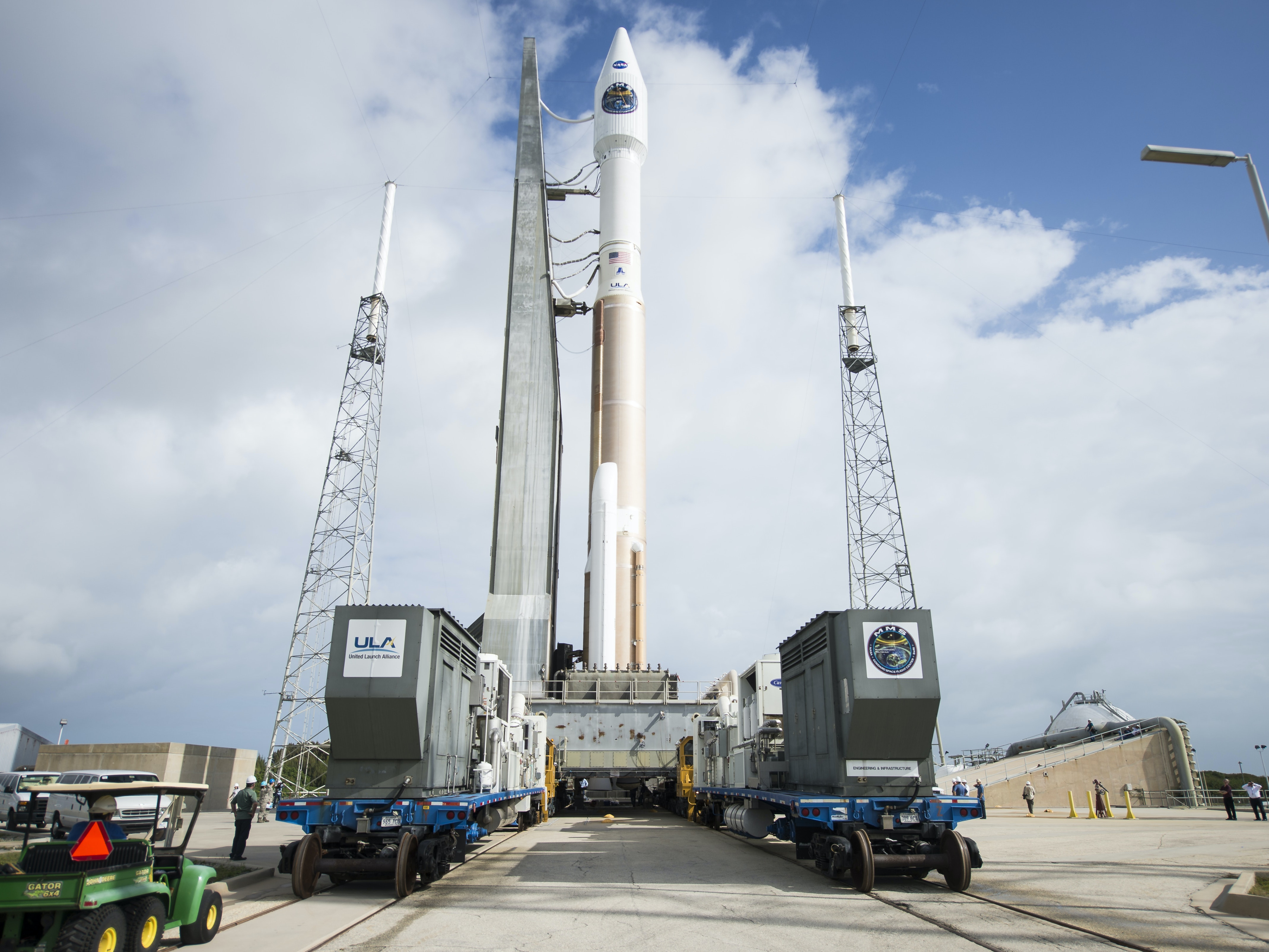 In the handout photo from NASA, the United Launch Alliance Atlas V rocket with NASA's Magnetospheric Multiscale (MMS) spacecraft onboard rolls out of the Cape Canaveral Air Force Station Space Launch Complex 41 Vertical Integration Facility to the launch pad, on March 11, 2015 in Cape Canaveral, Florida. Launch of the Atlas V rocket is scheduled for March 12 and will carry the four identical MMS spacecraft into orbit to provide the first three-dimensional view of magnetic reconnection.