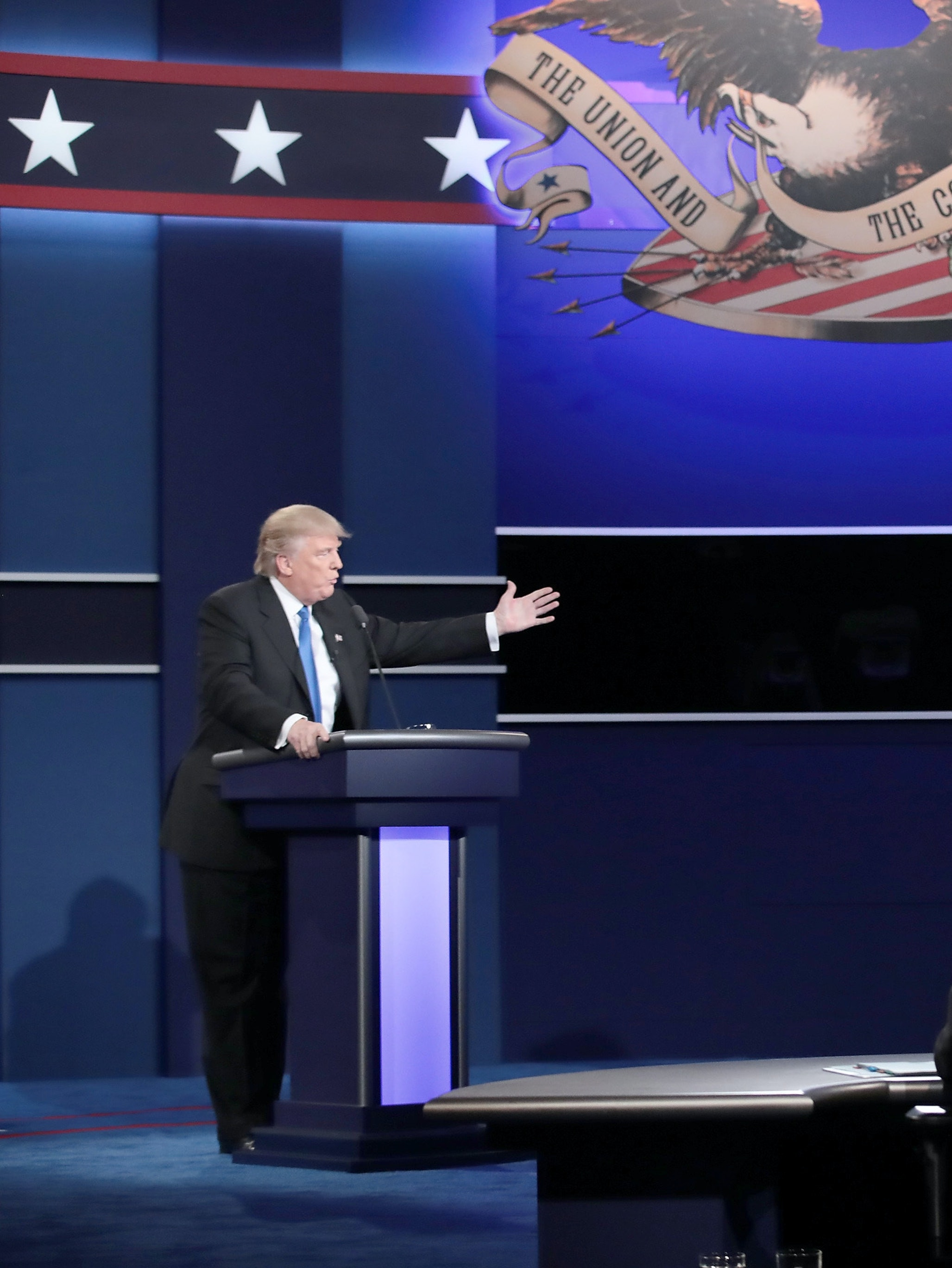 HEMPSTEAD, NY - SEPTEMBER 26:  Republican presidential nominee Donald Trump (L) speaks as Democratic presidential nominee Hillary Clinton (R) listens during the Presidential Debate at Hofstra University on September 26, 2016 in Hempstead, New York.  The first of four debates for the 2016 Election, three Presidential and one Vice Presidential, is moderated by NBC's Lester Holt.  (Photo by Drew Angerer/Getty Images)