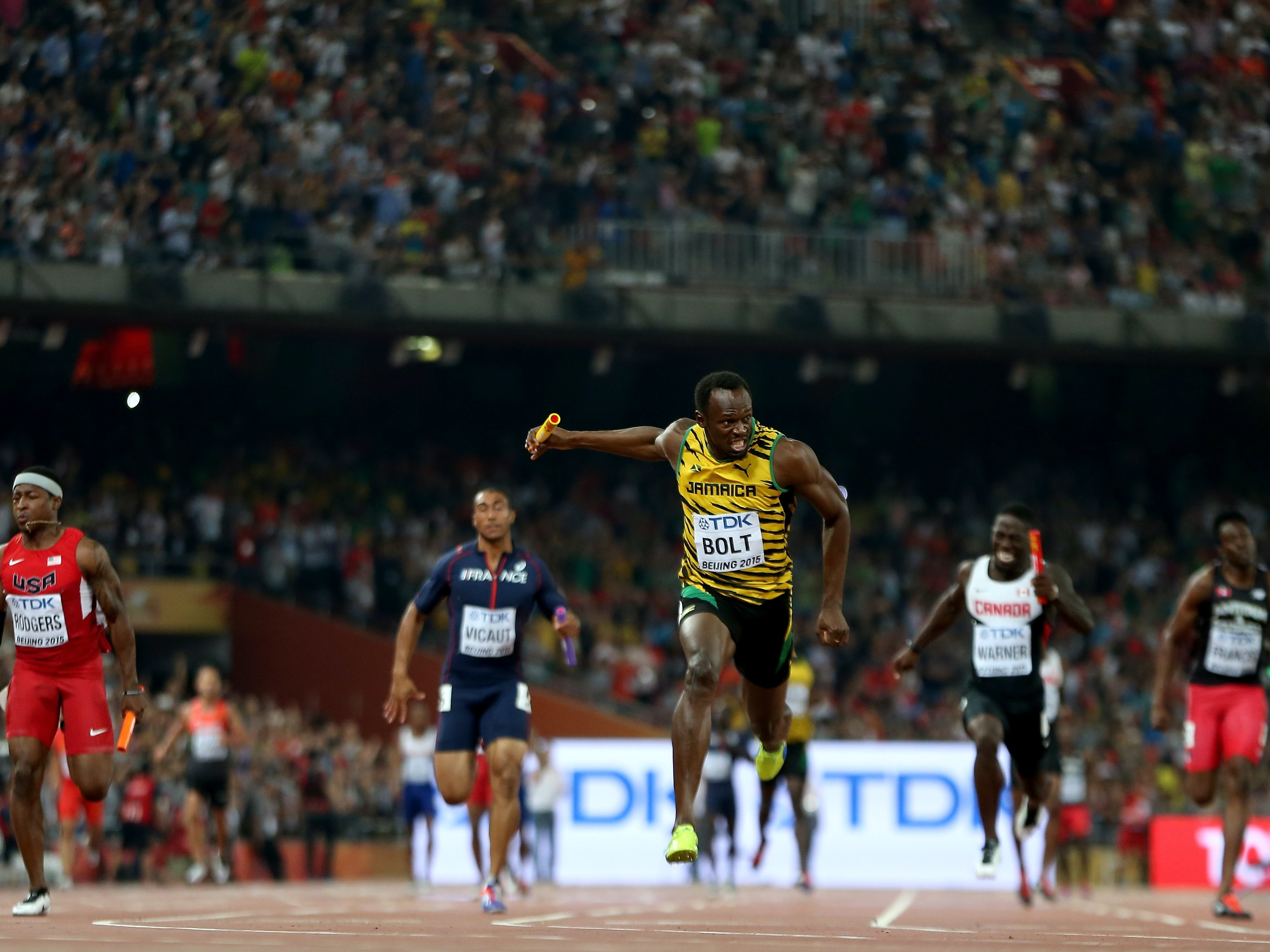 Usain Bolt crosses the finish line to win gold in the 4x100 meter relay at the IAAF World Athletics Championships Beijing in 2015.