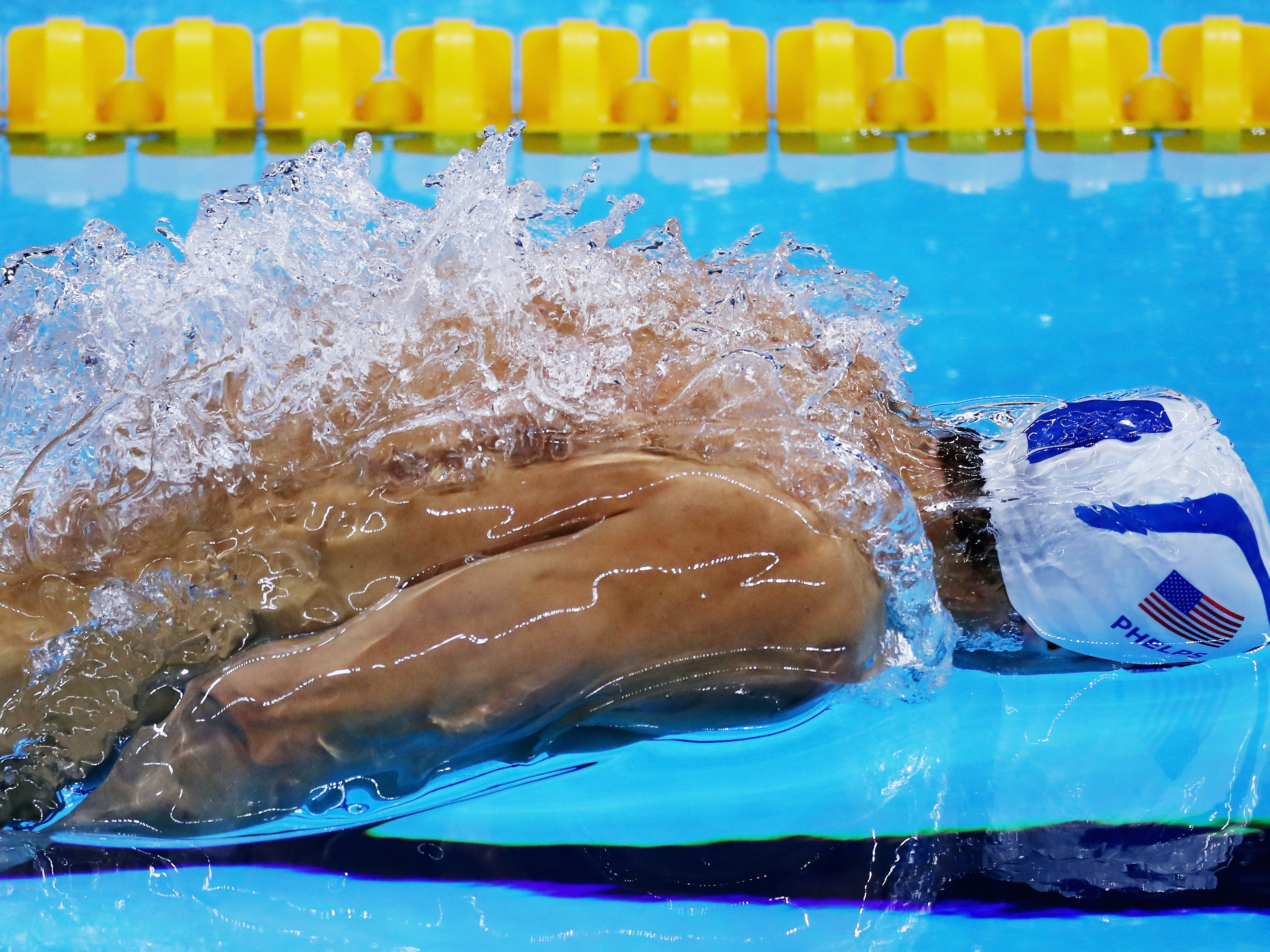 RIO DE JANEIRO, BRAZIL - AUGUST 11:  : Michael Phelps of the United States competes Men's 100m Butterfly heat on Day 6 of the Rio 2016 Olympic Games at the Olympic Aquatics Stadium on August 11, 2016 in Rio de Janeiro, Brazil.  (Photo by Al Bello/Getty Images)