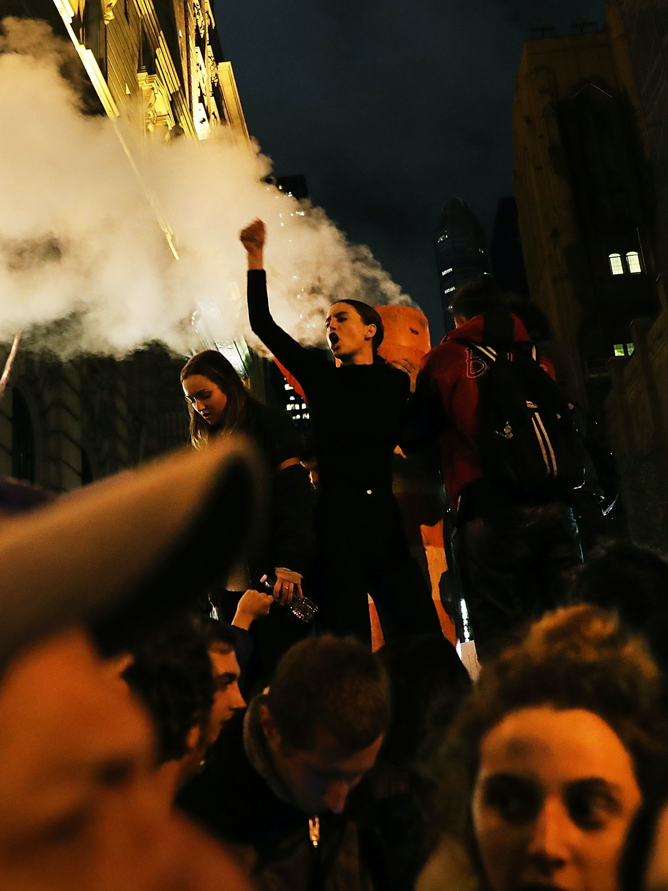 NEW YORK, NY - NOVEMBER 09:  Anti-Trump protesters shut down 5th Avenue in front of Trump Tower as New Yorkers react to the election of Donald Trump as president of the United States on November 9, 2016 in New York City. People around the country and the world are stunned with the outcome of the election for the 45th president.  (Photo by Spencer Platt/Getty Images)