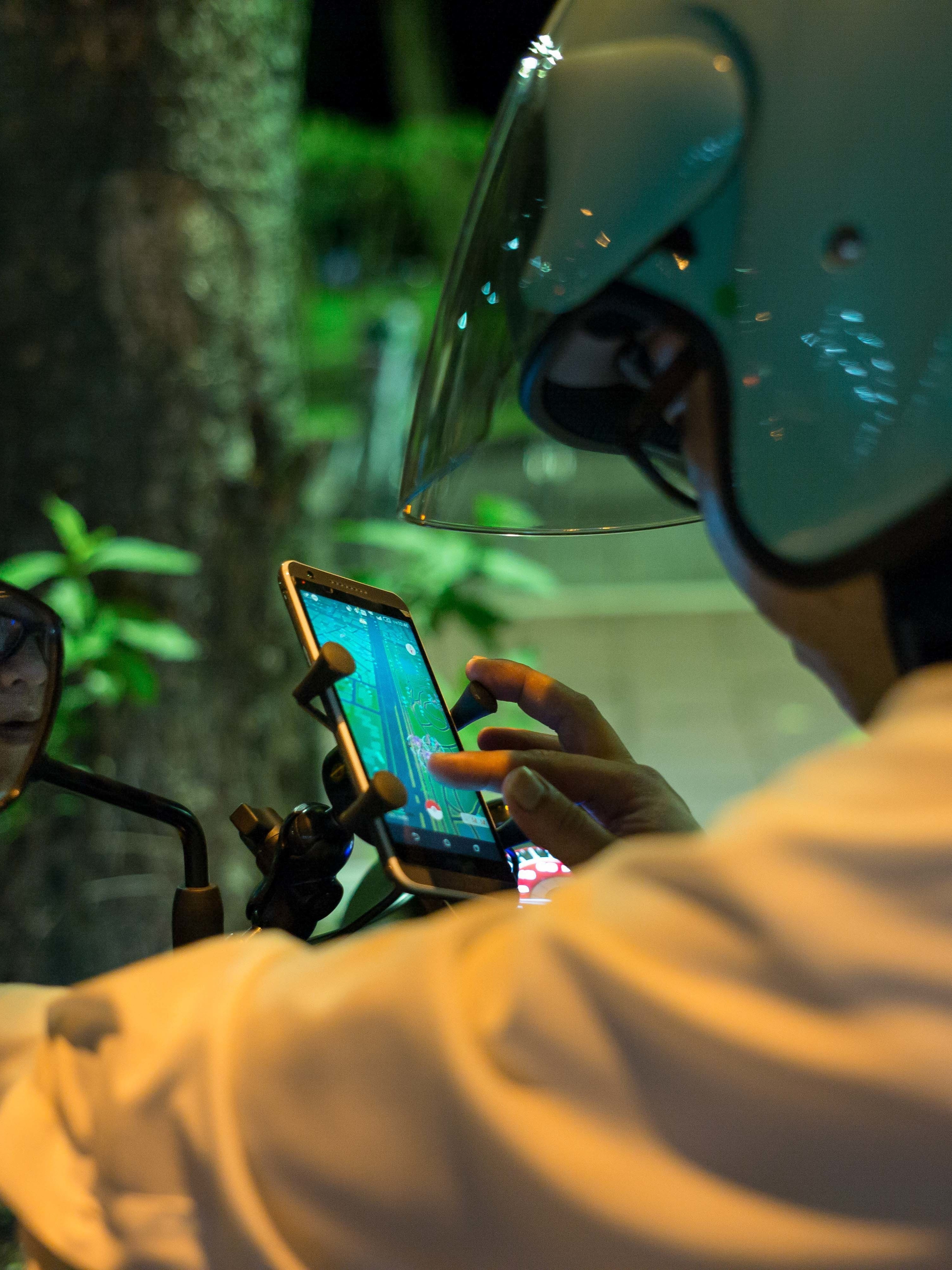 TAIPEI, TAIWAN - AUGUST 07:  Motorcyclists play Pokemon Go  on their smartphones on August 7, 2016 in Taipei, Taiwan. 'Pokemon Go,' which has been a smash-hit across the globe was launched in Taiwan on 6th August. Since its global launch, the mobile game has been an unexpected megahit among users who have taken to the streets with their smartphones.  (Photo by Billy H.C. Kwok/Getty Images)