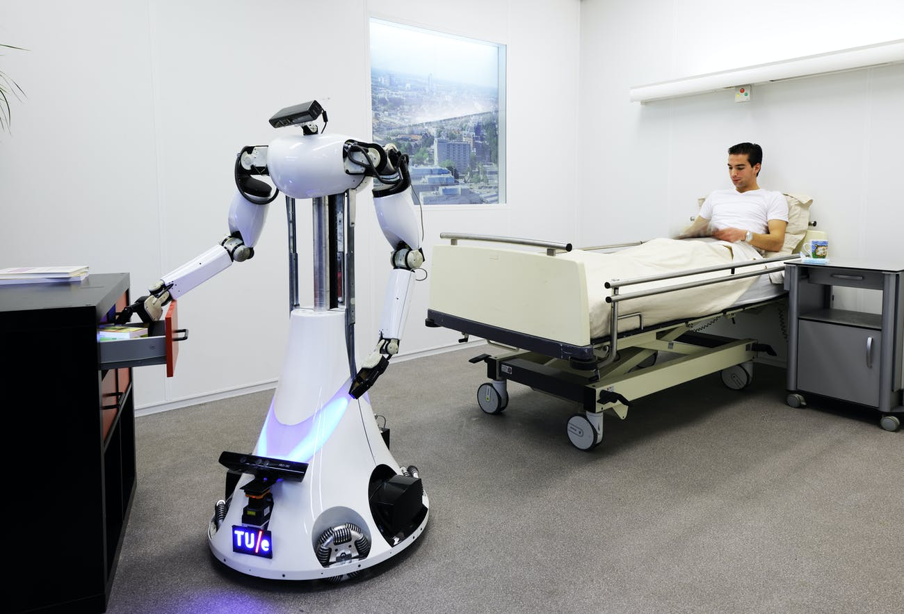 A demonstration during the RoboCup Dutch Open in 2012 imagines what a robot caregiver might look like in the healthcare industry.