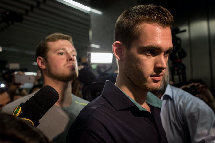 U.S Olympic swimmers Gunnar Bentz and Jack Conger leave the police headquarters at International departures of Rio de Janiero's Galeo International airport on August 18, 2016 in Rio de Janiero, Brazil. The swimmers were removed from their flight departing for the United States by Brazilian authorities in relation to an armed robbery incident earlier in the week which included fellow U.S swimmers Ryan Lochte and James Feign.