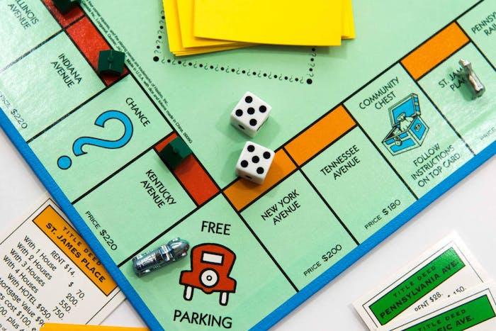 monopoly board orange red free parking car