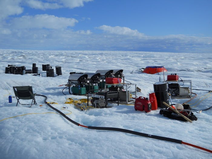 A system of pumps and heaters generates a high pressure jet of hot water that is used to melt a hole to the bottom of Greenland ice sheet.