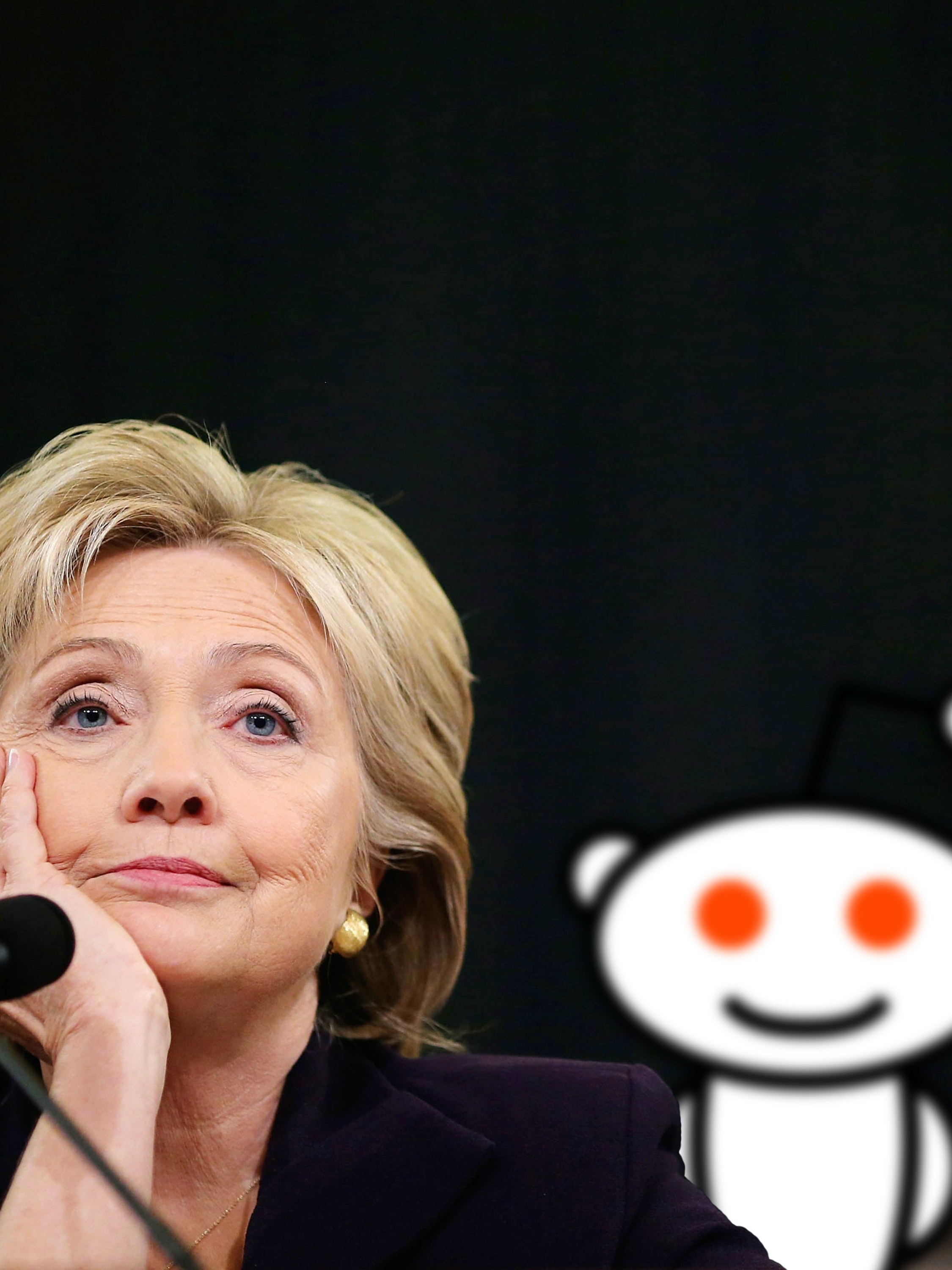 Hillary Clinton during the Benghazi scandals with the Reddit Snoo alien superimposed in the background.