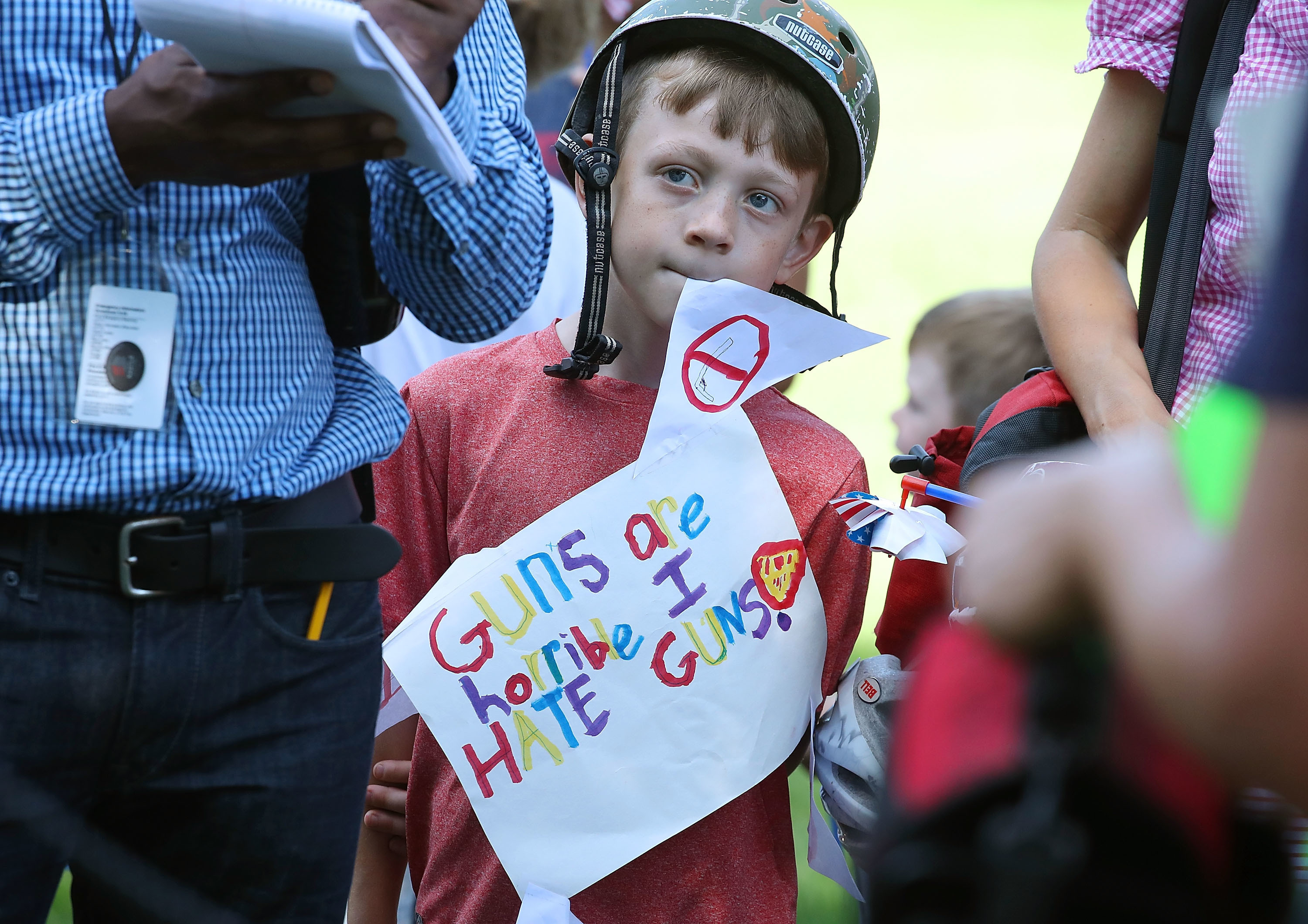 A young boy carries an anti-gun poster during a rally at the Capitol Hill, July 5, 2016 in Washington, DC.