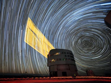 Long-Exposure Image Shows Telescope Lasers in Action