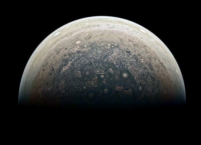 In this reprocessed image, we get a birds-eye view of Jupiter's south pole.
