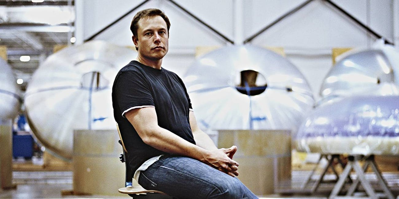 Elon Musk sitting