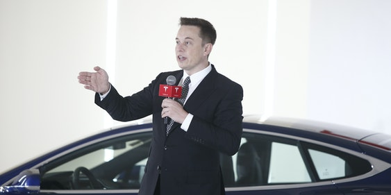 BEIJING, CHINA - OCTOBER 23: (CHINA OUT) Elon Musk, Chairman, CEO and Product Architect of Tesla Motors, addresses a press conference to declare that the Tesla Motors releases v7.0 System in China on a limited basis for its Model S, which will enable self-driving features such as Autosteer for a select group of beta testers on October 23, 2015 in Beijing, China. The v7.0 system includes Autosteer, a new Autopilot feature. While it's not absolutely self-driving and the driver still need to hold the steering wheel and be mindful of road conditions and surrounding traffic when using Autosteer. When set to the new Autosteer mode, graphics on the driver's display will show the path the Model S is following, post the current speed limit and indicate if a car is in front of the Tesla.  (Photo by VCG/VCG via Getty Images)