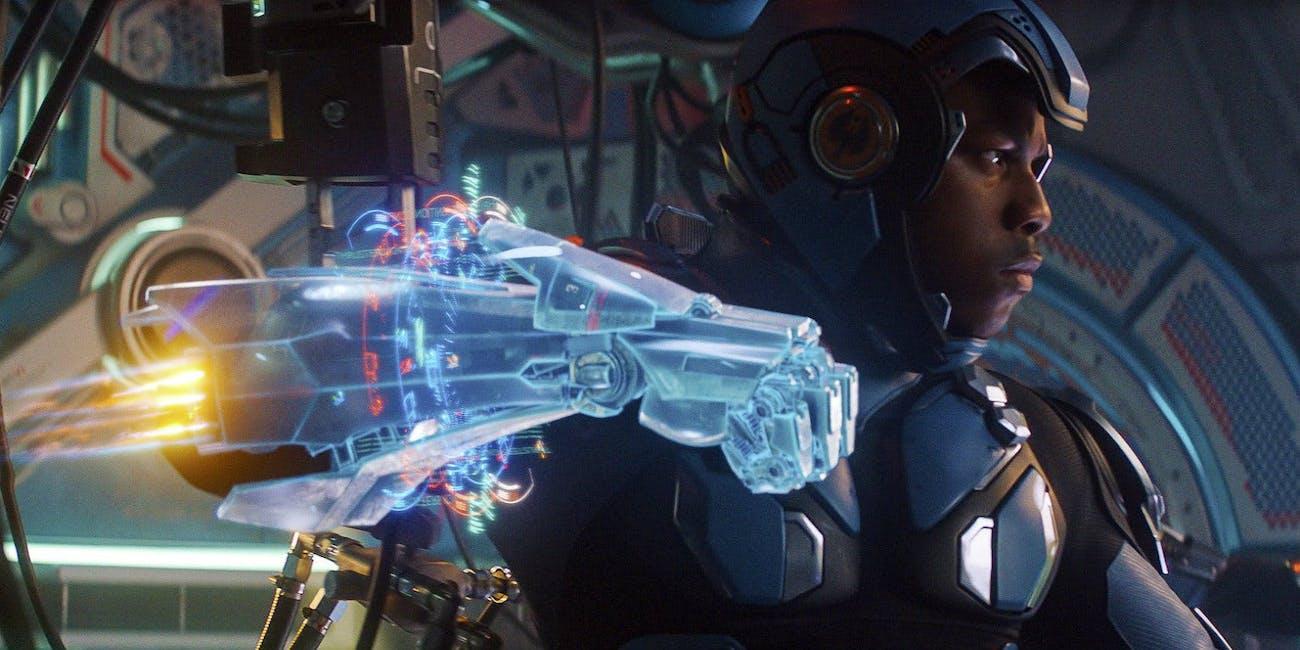 John Boyega as Jake Pentecost in 'Pacific Rim Uprising' throwing a punch in Gipsy Avenger.