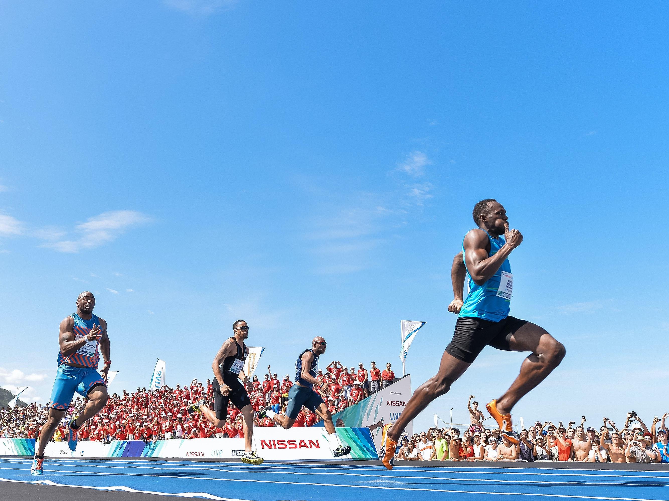 Usain Bolt of Jamaica runs to win the 'Mano a Mano' Men's 100m challenge at Copacabana beach on August 17, 2014 in Rio de Janeiro, Brazil.