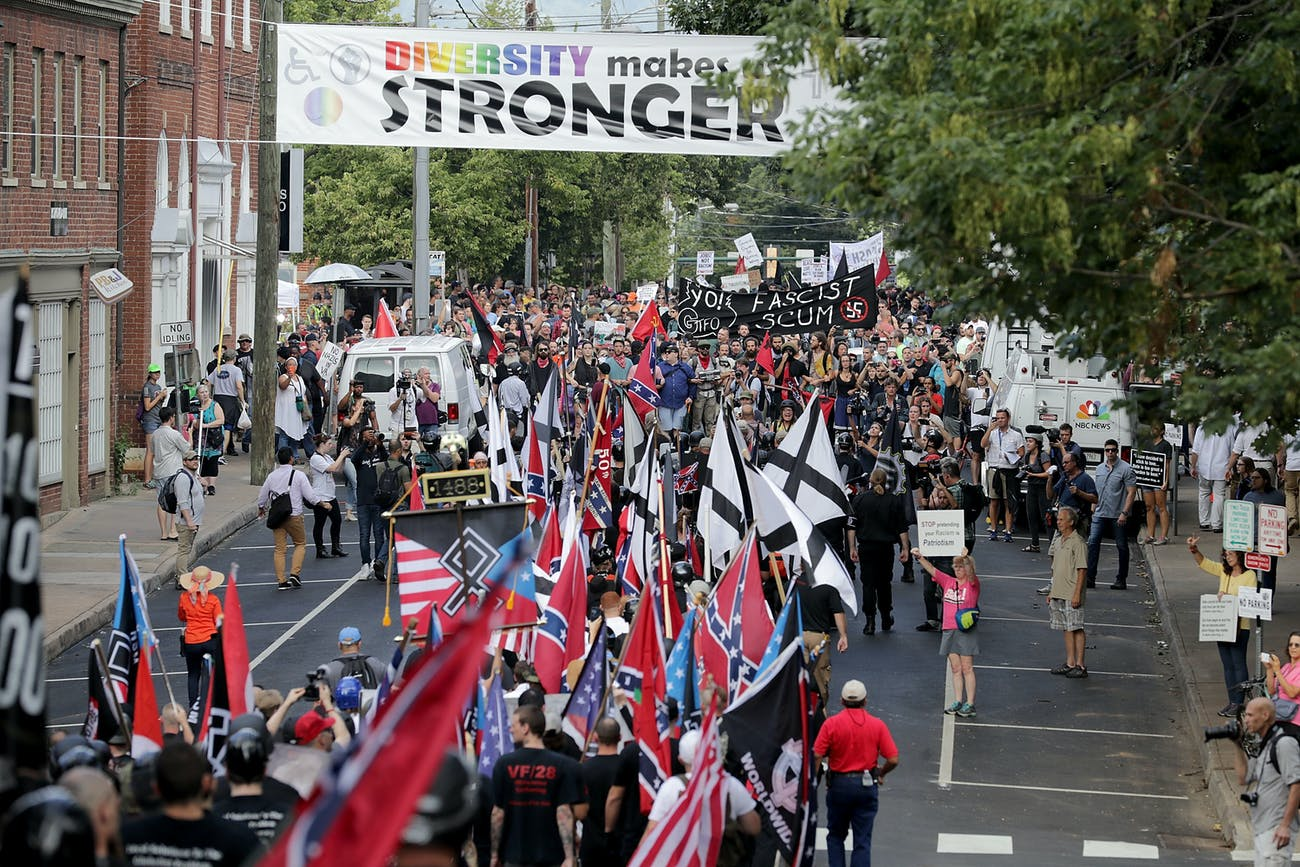 CHARLOTTESVILLE, VA - AUGUST 12: Hundreds of white nationalists, neo-Nazis and members of the 'alt-right' march down East Market Street toward Lee Park during the 'Unite the Right' rally August 12, 2017 in Charlottesville, Virginia. After clashes with anti-fascist protesters and police the rally was declared an unlawful gathering and people were forced out of Lee Park, where a statue of Confederate General Robert E. Lee is slated to be removed. (Photo by Chip Somodevilla/Getty Images)