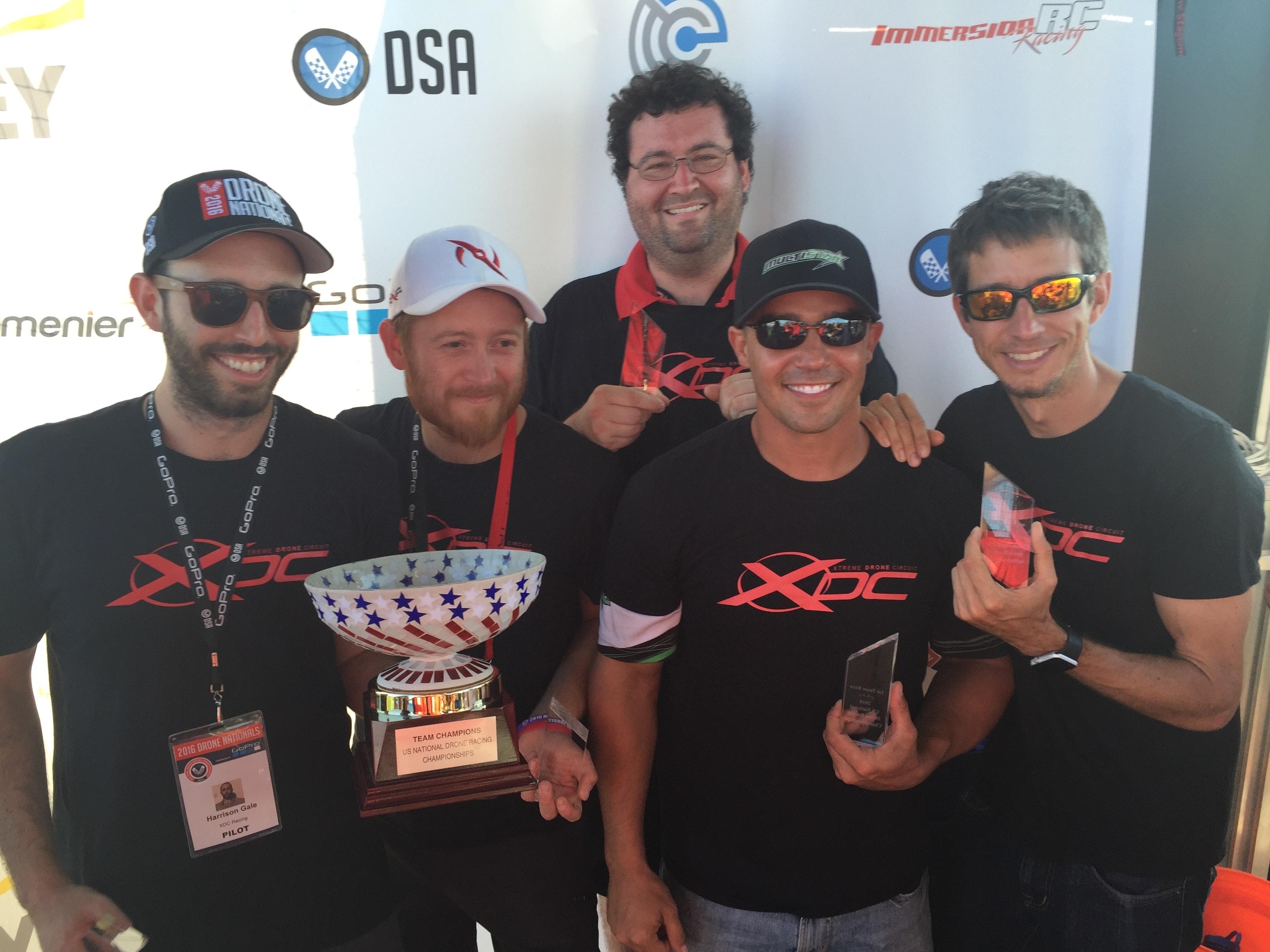 Morris, far right, celebrating his win.
