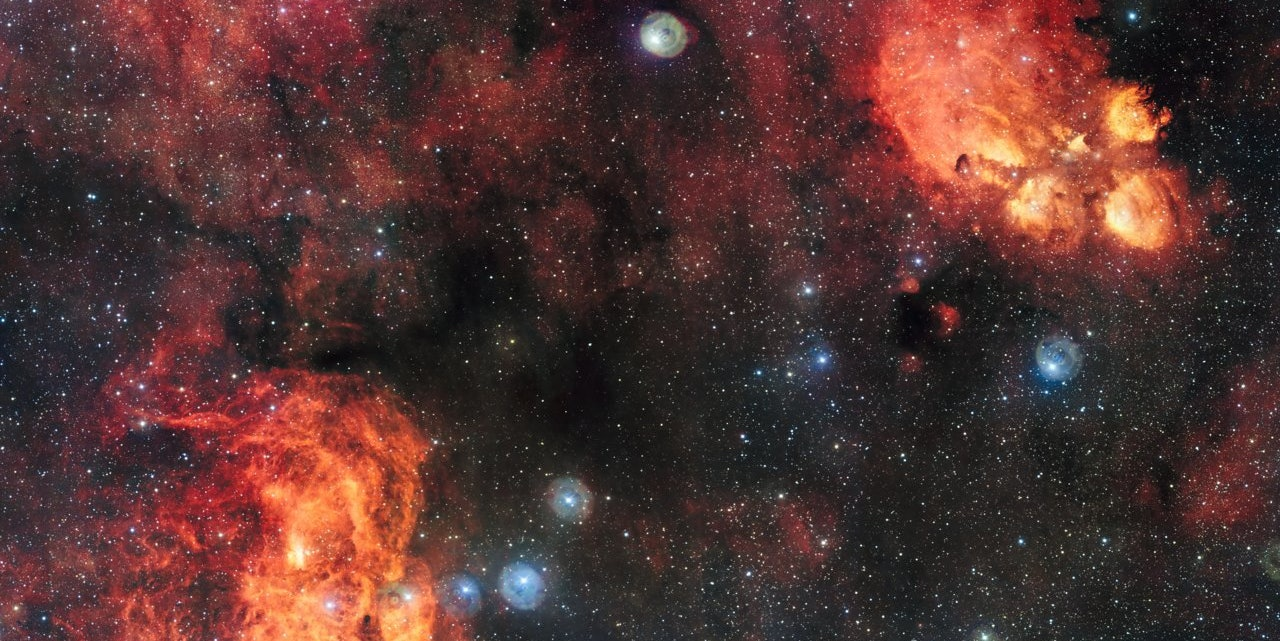 This Wicked Glimpse of Two Gorgeous Nebulas Feels Infinitely Long