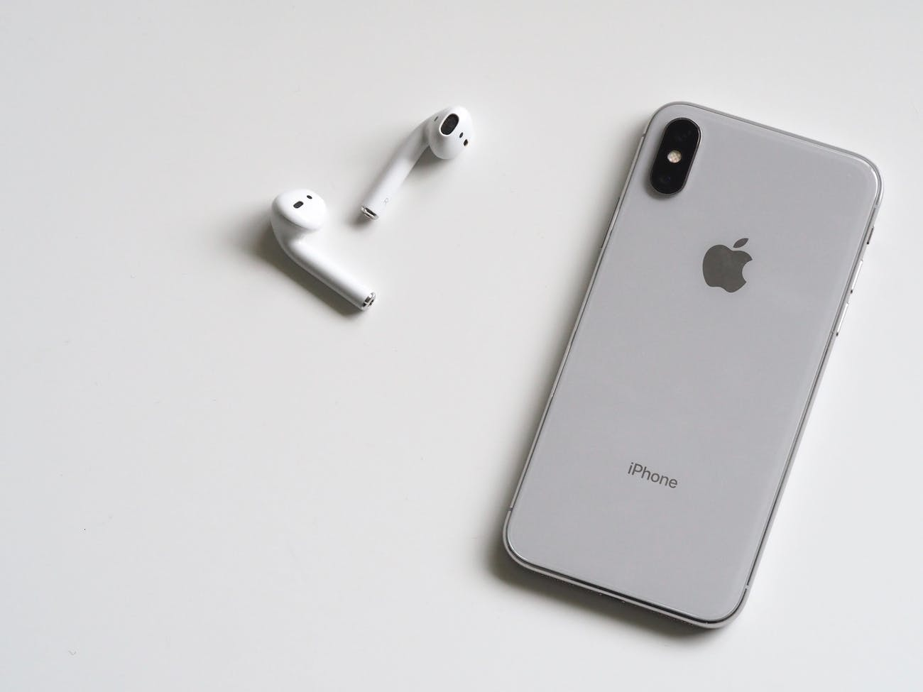 Silver Iphone X With Airpods
