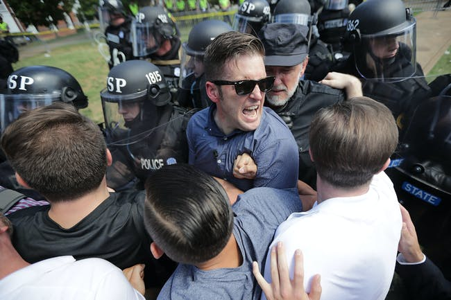 Spencer and his supporters clash with Virginia State Police in Emancipation Park after the 'Unite the Right' rally was declared an unlawful gathering August 12, 2017 in Charlottesville, Virginia.
