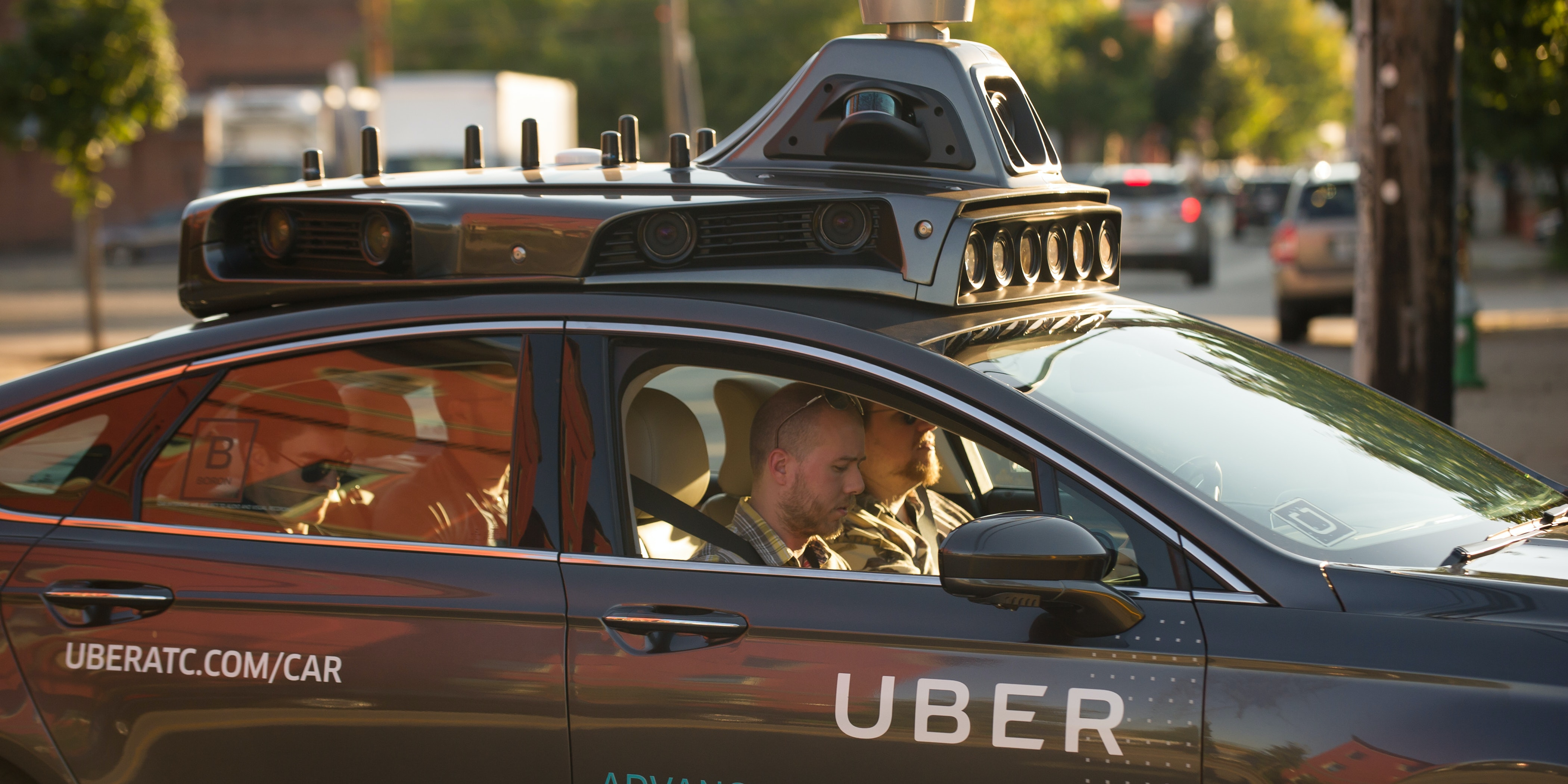 PITTSBURGH, PA - SEPTEMBER 22: An Uber driverless Ford Fusion drives down Smallman Street on September, 22, 2016 in Pittsburgh, Pennsylvania. Uber has built its Uber Technical Center in Pittsburgh and is developing an autonomous vehicle that it hopes will be able to transport its millions of clients without the need for a driver.
