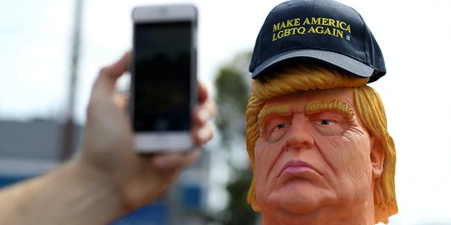 SAN FRANCISCO, CA - AUGUST 18:  A passerby takes a picture of a statue depicting republican presidential nominee Donald Trump in the nude on August 18, 2016 in San Francisco, United States.  Anarchist collective INDECLINE has created five statues depicting Donald Trump in the nude and placed them in five U.S. cities on Thursday morning. The statues are in San Francisco, New York, Los Angeles, Cleveland and Seattle.  (Photo by Justin Sullivan/Getty Images)