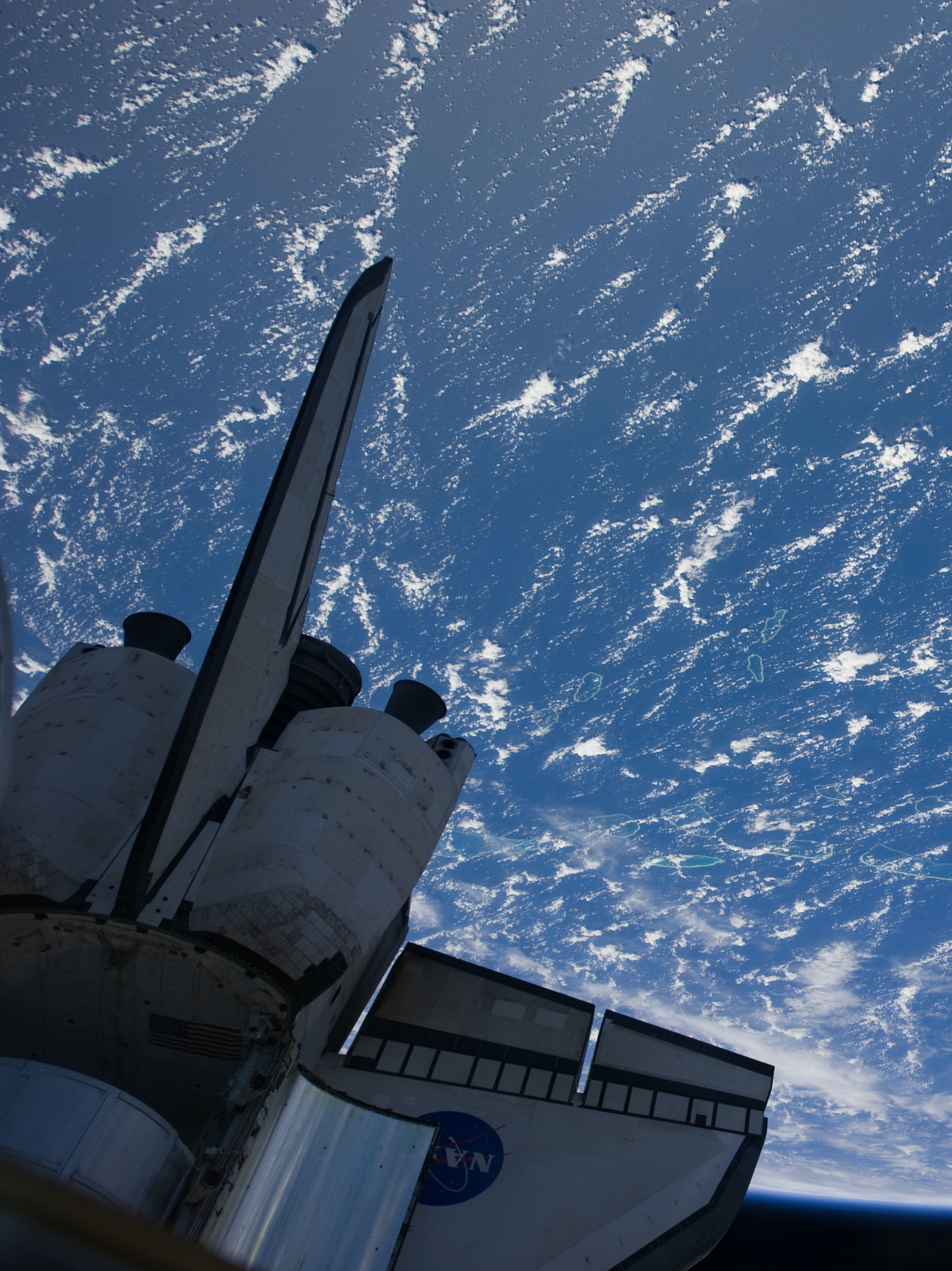 Space Shuttle Discovery Over Earth (NASA, International Space Station, 02/26/11)
