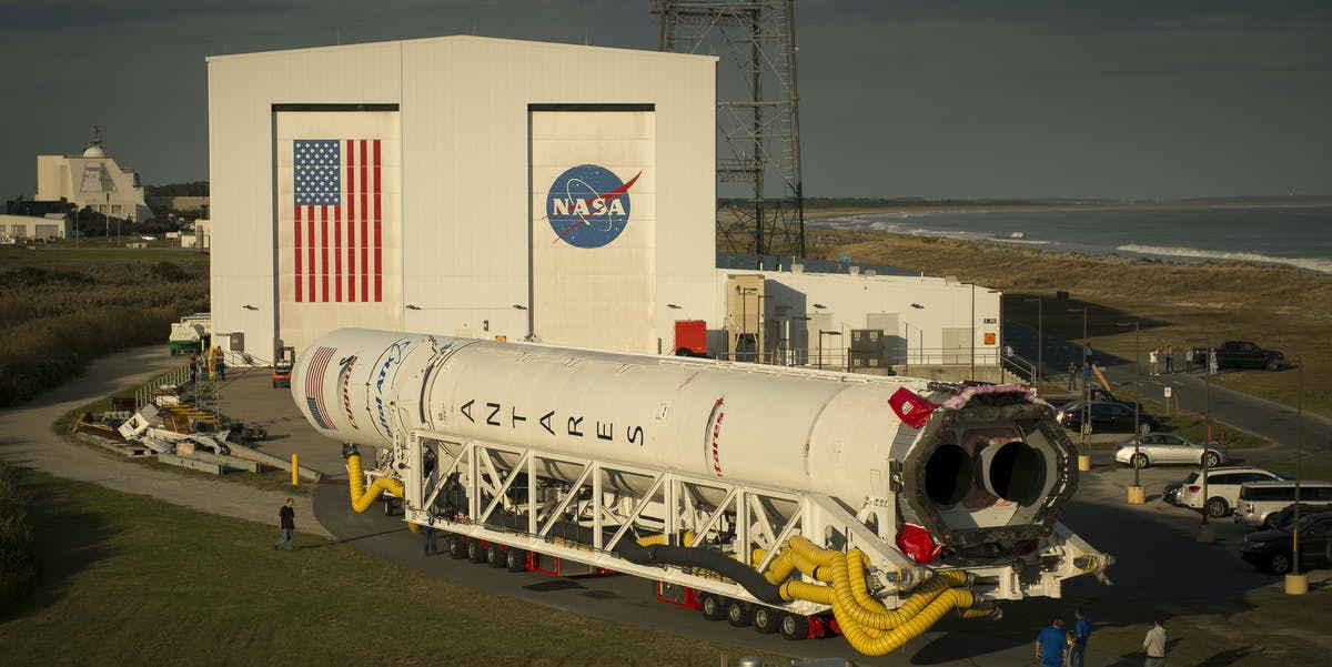 The Orbital ATK Antares rocket, with the Cygnus spacecraft onboard, is rolled out of its Horizontal Integration Facility.