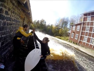Watch These Swedish Guys Surf a Homemade Wave in a Mill Stream