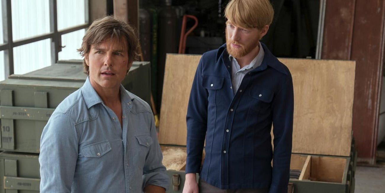 Tom Cruise as Barry Seal and Domhnall Gleeson as Agent Monty Schafer.
