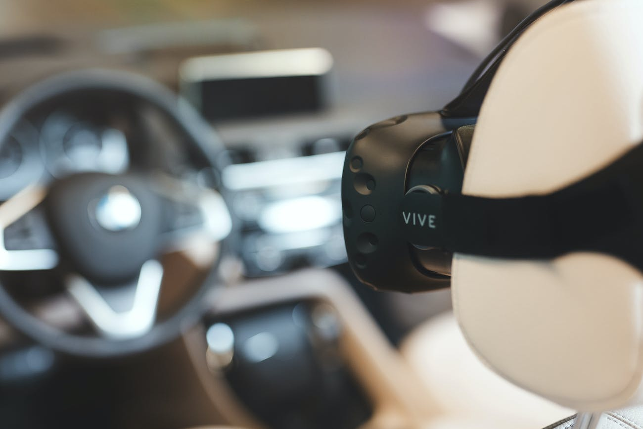 The HTC Vive facing a steering wheel.