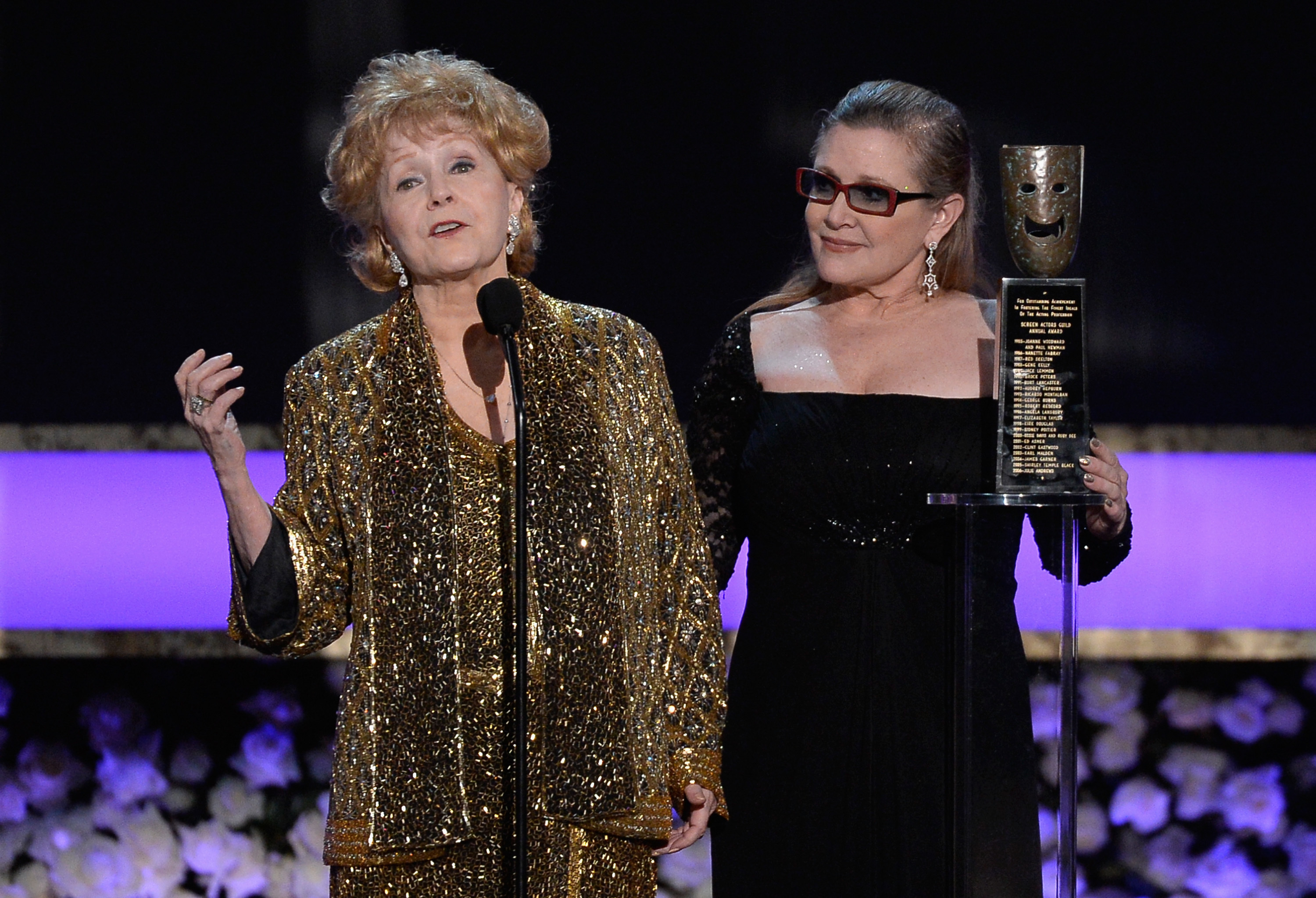 Debbie Reynolds accepts the Life Achievement Award from Carrie Fisher onstage at the 21st Annual Screen Actors Guild Awards on January 25, 2015.