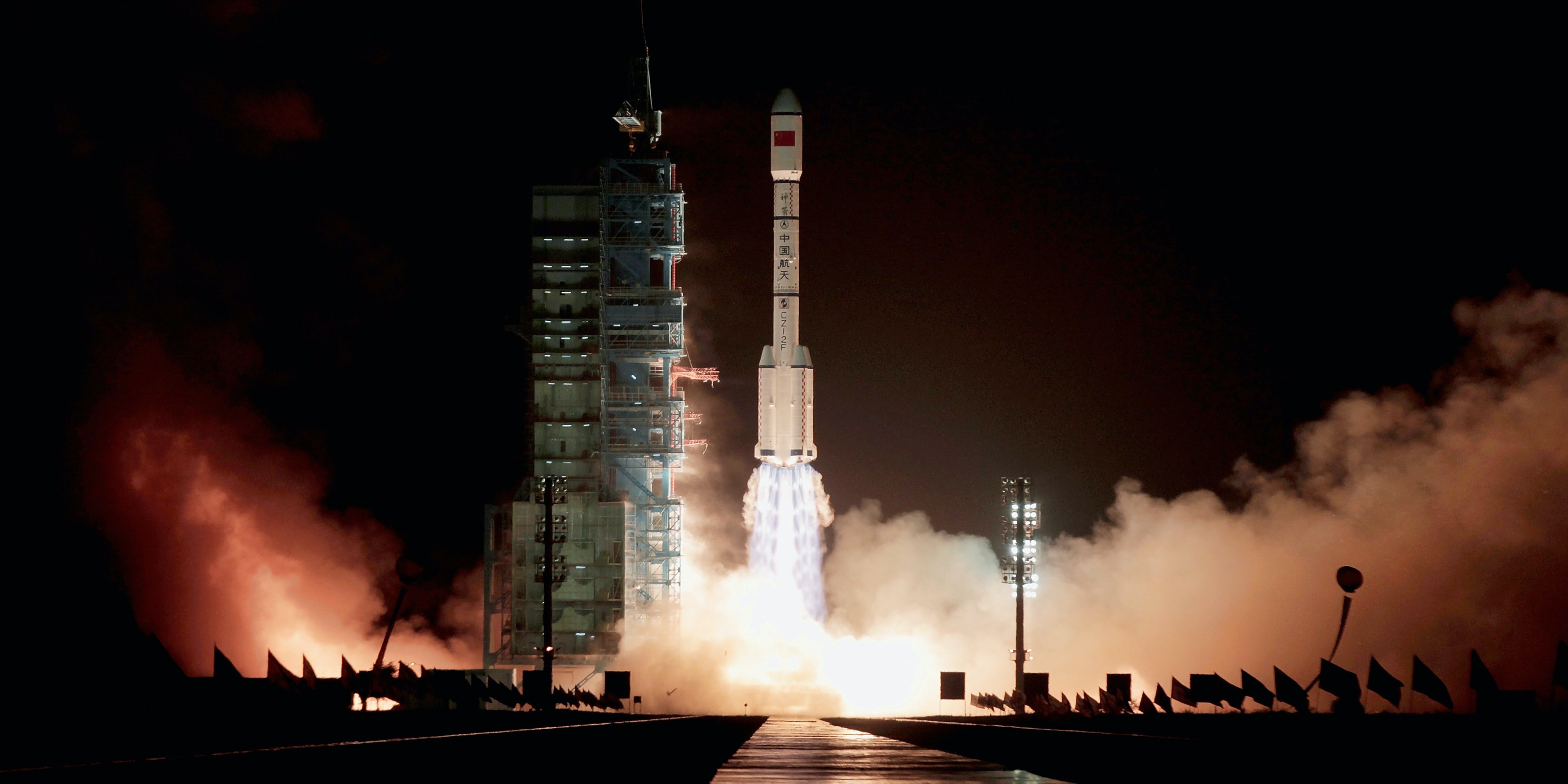 JIUQUAN, CHINA - SEPTEMBER 29:  A Long March 2F rocket carrying the country's first space laboratory module Tiangong-1 lifts off from the Jiuquan Satellite Launch Center on September 29, 2011 in Jiuquan, Gansu province of China. The unmanned Tiangong-1 will stay in orbit for two years and dock with China's Shenzhou-8, -9 and -10 spacecraft with the eventual goal of establishing a manned Chinese space station around 2020.  (Photo by Lintao Zhang/Getty Images)